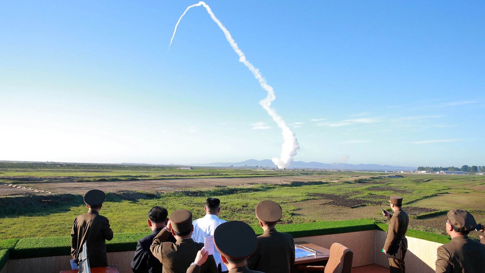 North Korean leader Kim Jong Un watches the test of a new-type anti-aircraft guided weapon system organized by the Academy of National Defense Science in this undated photo released by North Korea's Korean Central News Agency (KCNA) May 28, 2017. K