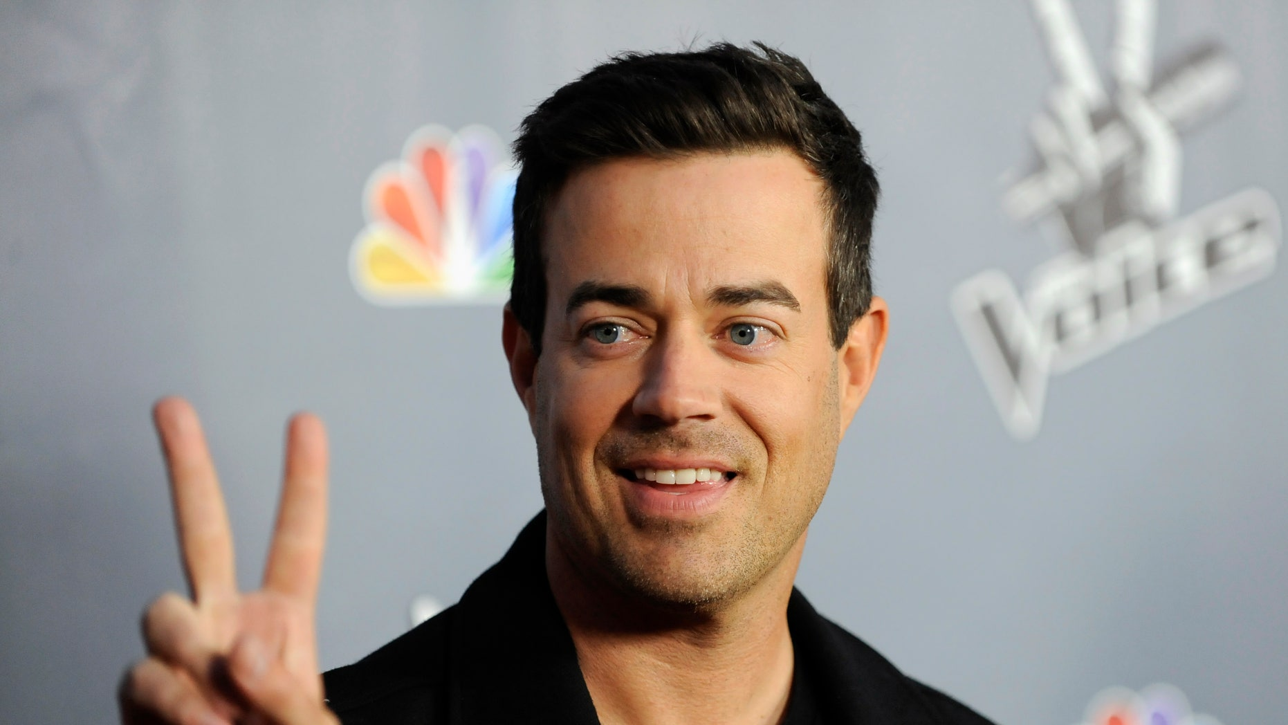 "Television personality and ""The Voice"" host Carson Daly arrives at the Season 4 premiere screening in Los Angeles, California March 20, 2013."