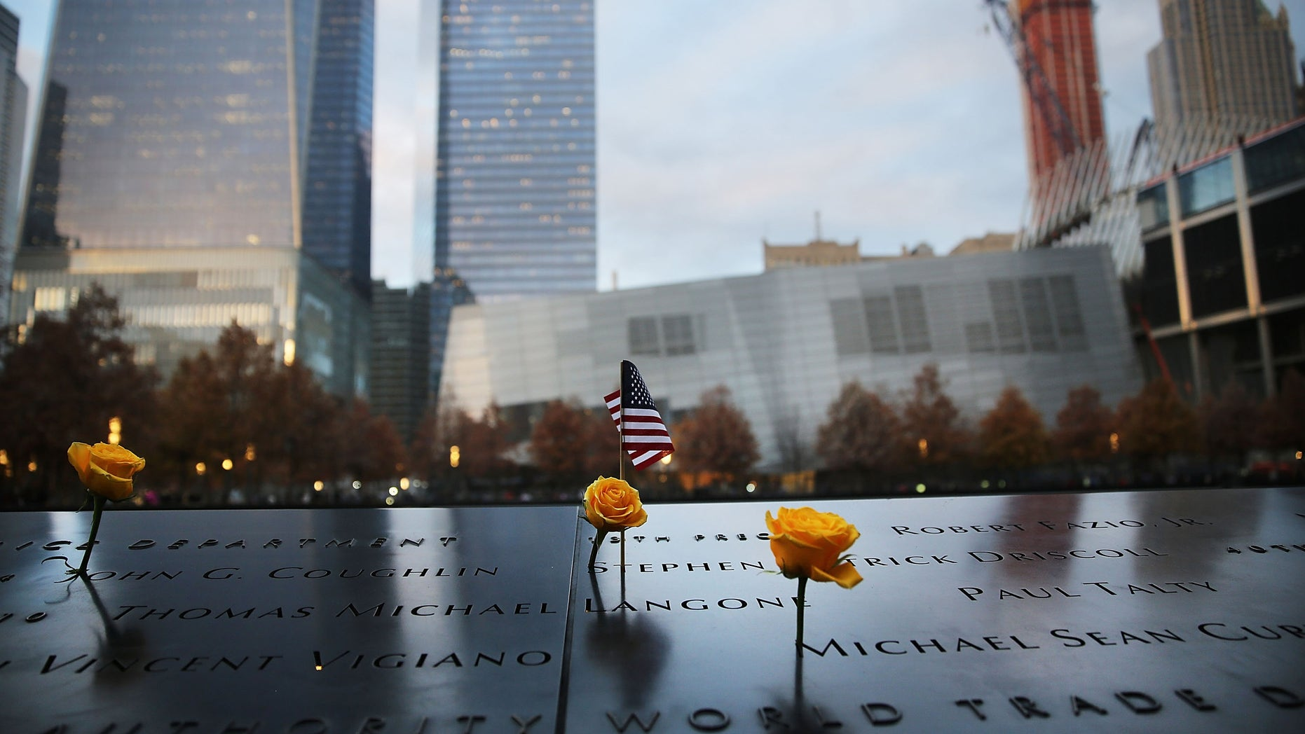 NEW YORK, NY - NOVEMBER 11:  Flowers are viewed at the 9/11 Memorial where flowers are placed on the names of veterans killed on September 11, 2001 for Veterans Day in New York on November 11, 2014 in New York City. New York celebrated the day with the annual Veteran's Day Parade, which is often called the largest Veteran's Day Parade in the country.  (Photo by Spencer Platt/Getty Images)