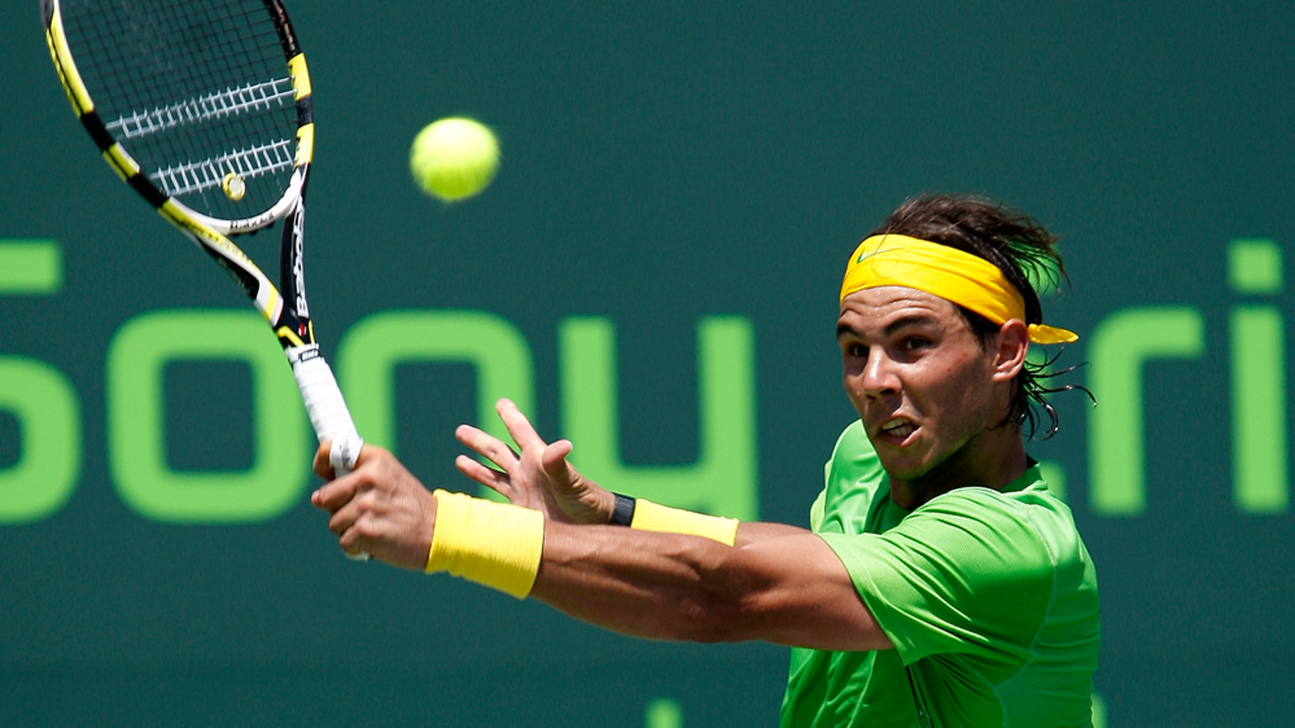 Rafael Nadal, of Spain, returns the ball to Novak Djokovic, of Serbia, at the final of the Sony Ericsson Open tennis tournament in Key Biscayne, Fla., Sunday, April 3, 2011. (AP Photo/J Pat Carter)