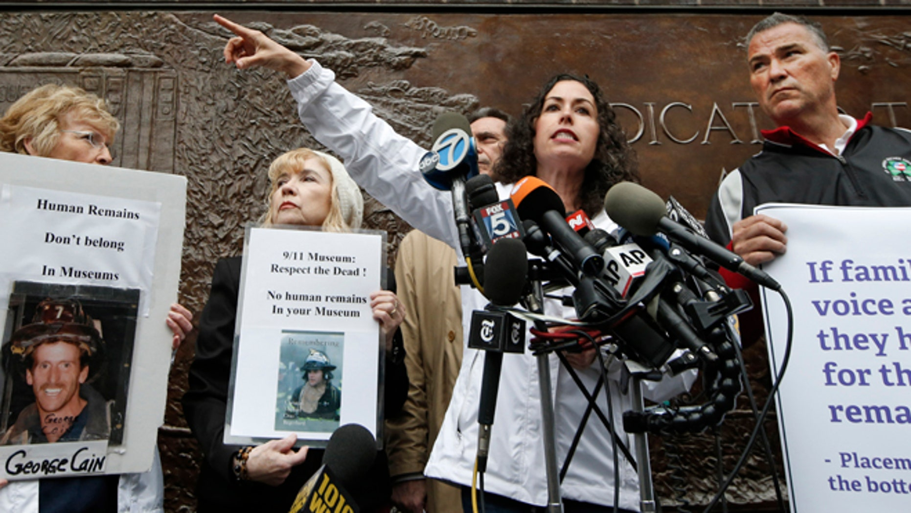 May 8, 2014: Rosaleen Tallon, sister of firefighter Sean Tallon, killed in the 9-11 World Trade Center attacks and other 9-11 victims' family members hold a press conference in front of a fire station opposite the National September 11 Memorial & Museum in New York.