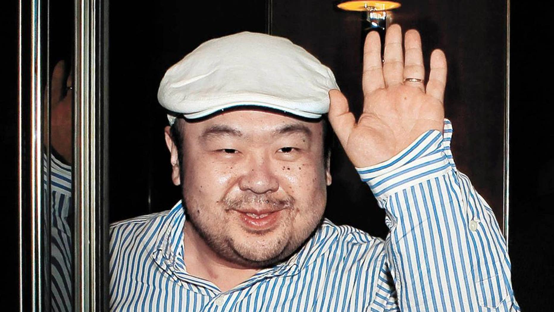 FILE - In this June 4, 2010, file photo, dressed in jeans and blue suede loafers, Kim Jong Nam, the eldest son of then North Korean leader Kim Jong Il, waves after his first-ever interview with South Korean media in Macau. Kim was assassinated at an airport in Kuala Lumpur, telling medical workers before he died that he had been attacked with a chemical spray a Malaysian official said Tuesday. (Shin In-seop/JoongAng Ilbo via AP, File)