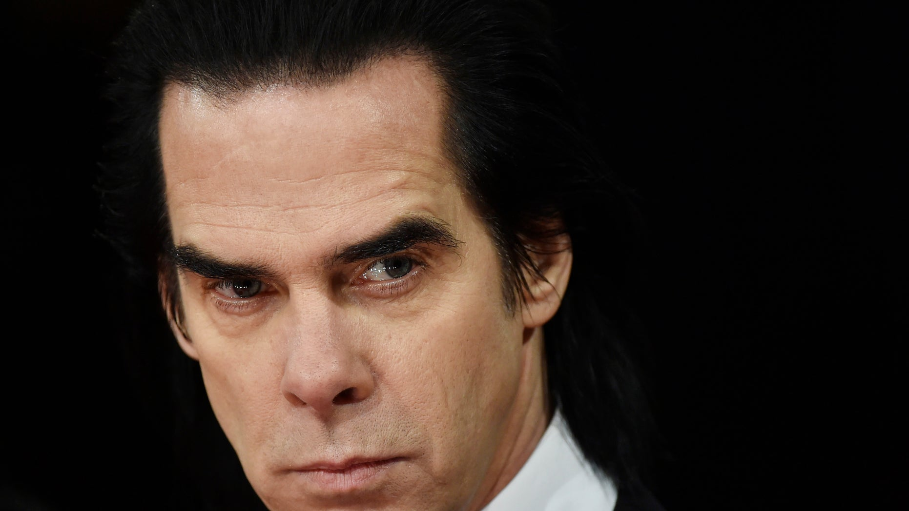 Australian musician Nick Cave arrives at the British Academy of Film and Arts (BAFTA) awards ceremony at the Royal Opera House in London February 8, 2015. REUTERS/Toby Melville (BRITAIN - Tags: ENTERTAINMENT) - RTR4OPSV