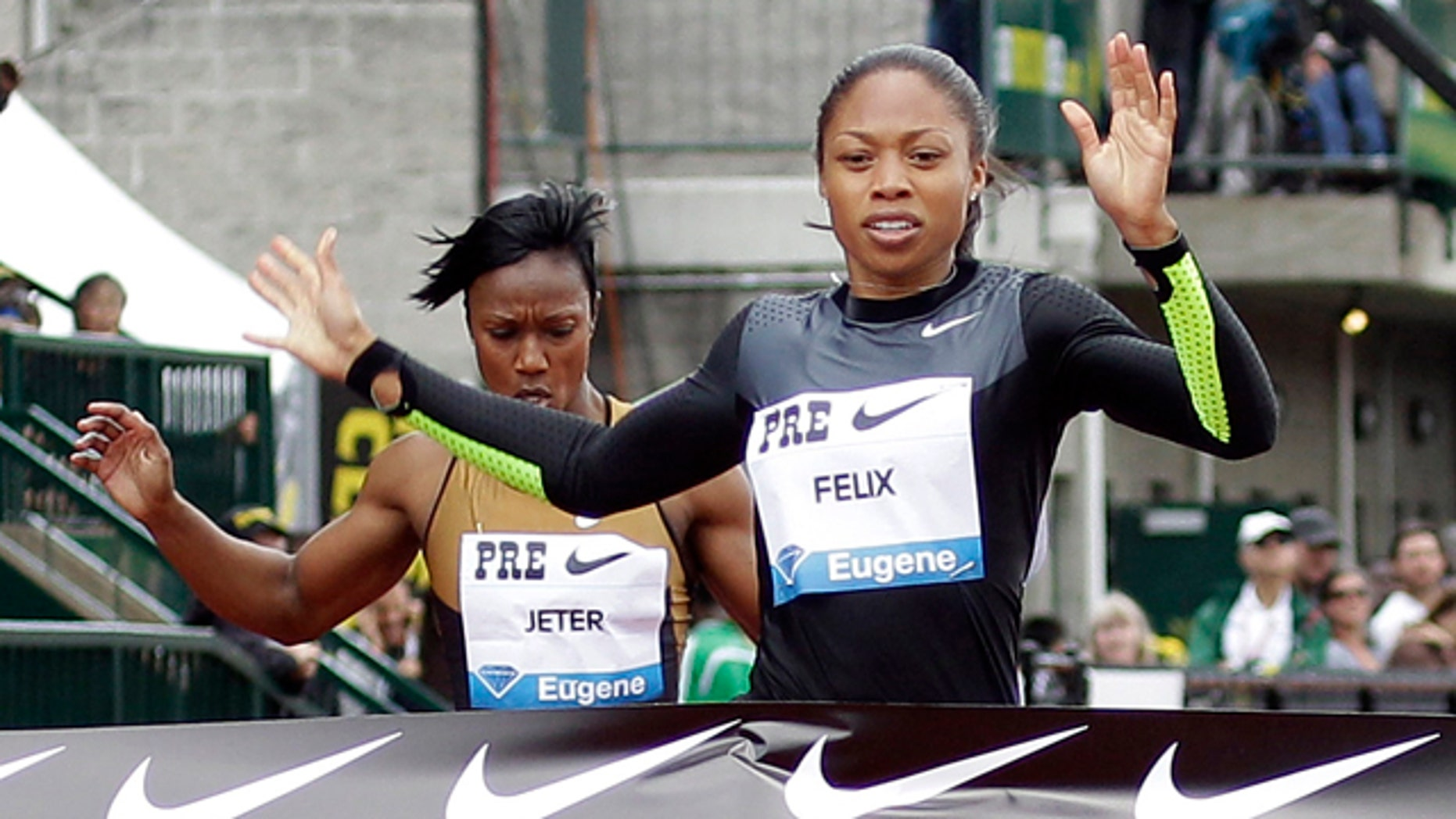 Allyson Felix will focus on the 100 and 200 meter races to maximize her chance of taking home the gold. (AP Photo)