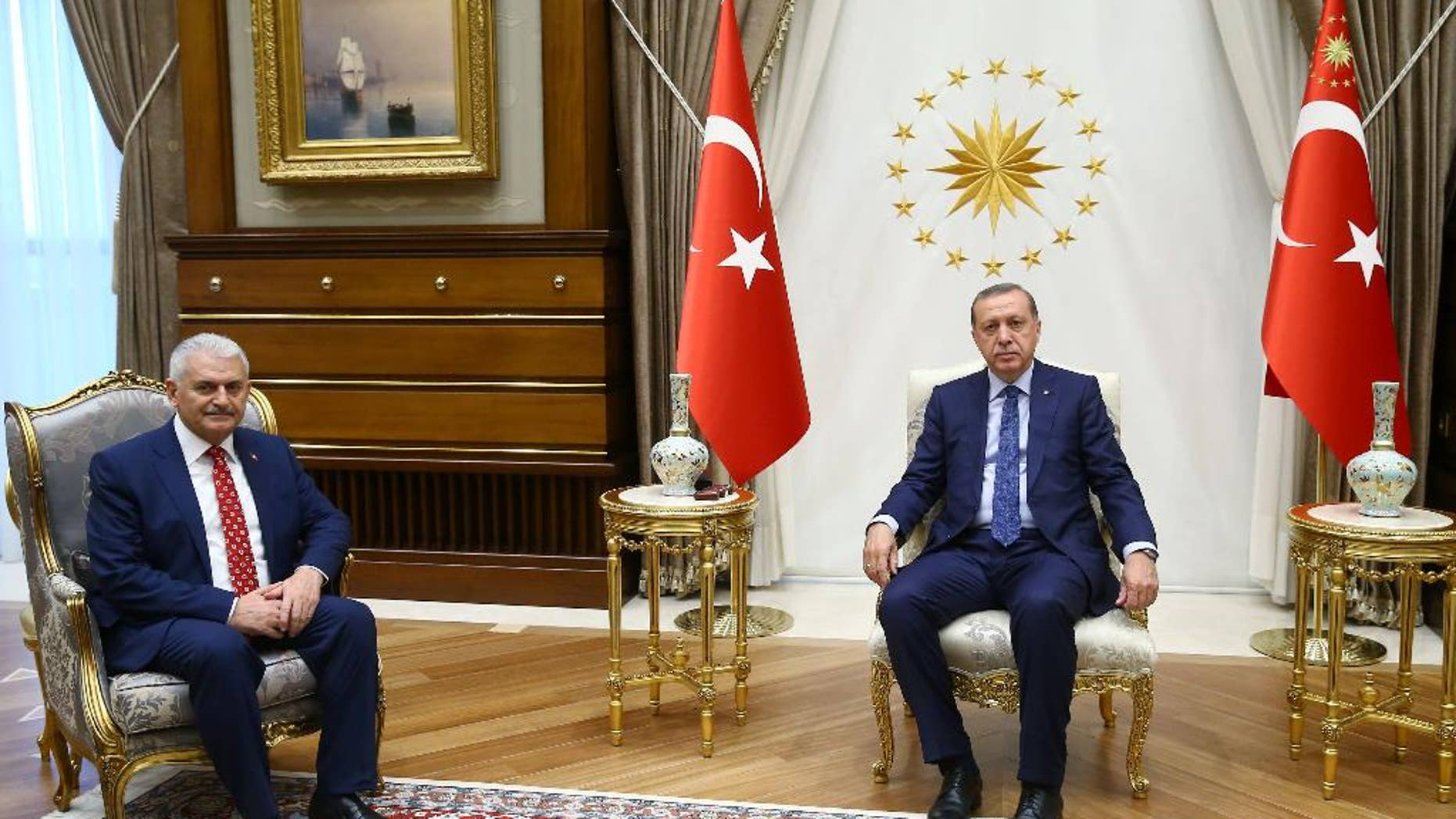 Turkey's President Recep Tayyip Erdogan, right, and Binali Yildirim, the ruling party's new chairman, pose for a photograph.