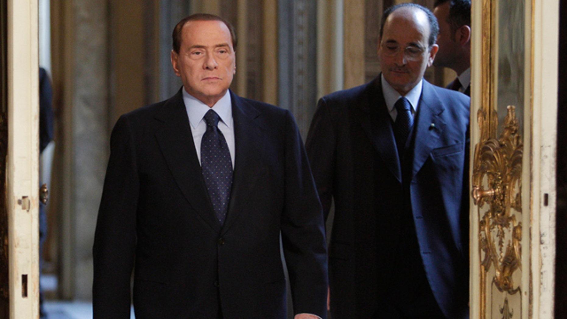 March 14: Italian premier Silvio Berlusconi arrives to meet European Commission president Jose Manuel Barroso, not in photo, at Palazzo Chigi in Rome. (AP)
