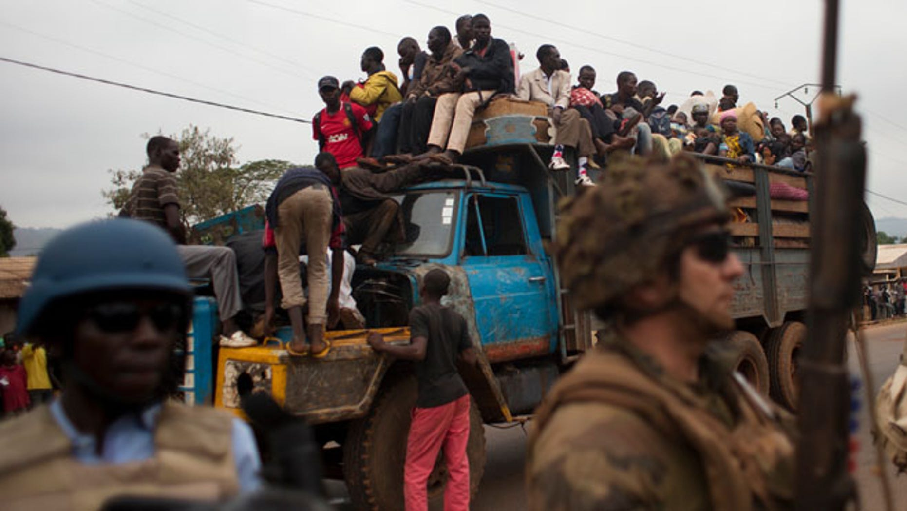 Dec. 27, 2013: In this file photo, French soldiers protect a truck of fleeing Muslims after it broke down and was surrounded by hundreds of hostile Christian residents, including several anti-balaka militiamen, in the Gobongo neighborhood of Bangui, Central African Republic.