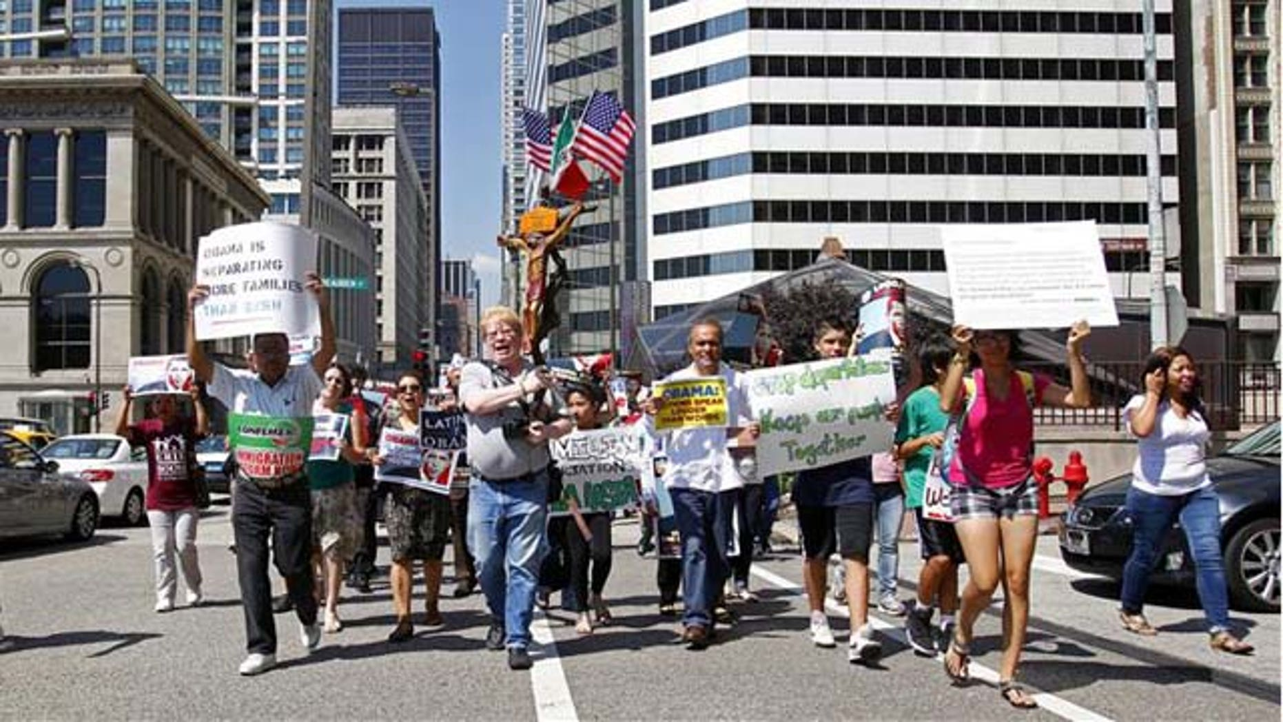 Pro-immigration reform activists protested on Tuesday in front of President Barack Obama's Chicago reelection campaign headquarters.