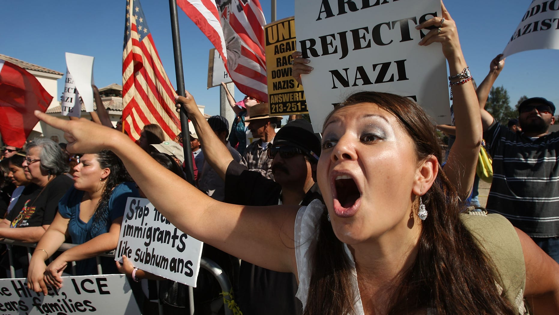 RIVERSIDE, CA - OCTOBER 24:  Counter-protester Erika Paz yells at members of the white supremacist group, the National Socialist Movement, during the NSMÕs anti-illegal immigration rally near a Home Depot store on October 24, 2009 in Riverside, California. It is the second such demonstration in Riverside by the Detroit-based Neo-Nazi group in the past month. The last rally was soon broken up by police after clashes with counter-protesters.   (Photo by David McNew/Getty Images)