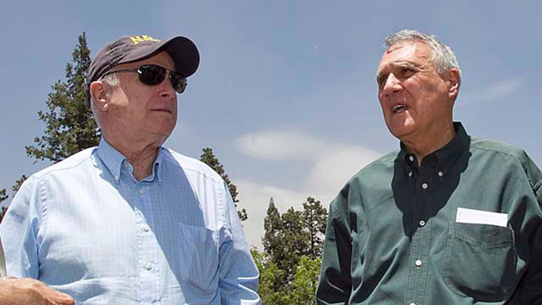 Sen. John McCain, right, with Sen. Jon Kyl in the forest surrounding Alpine, Ariz. Saturday, June 18, 2011 during a tour of the burned areas of the Wallow Fire. The fire has burned more than 500,000 acres in eastern Arizona. (AP Photo/The Arizona Republic, Tom Tingle) MARICOPA COUNTY OUT; MAGS OUT; NO SALES