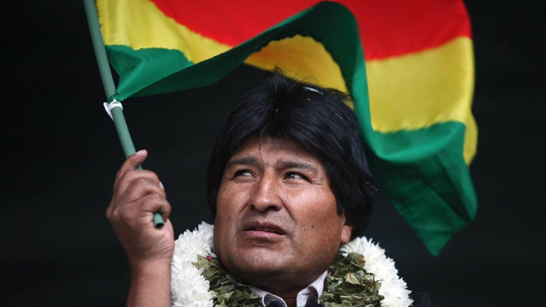"""FILE - In this Jan. 22, 2009 file photo, Bolivia's President Evo Morales waves a Bolivian flag during a rally in support of the proposed new constitution in Cochabamba, Bolivia. Morales inaugurated a $7 million museum on Feb. 2, 2017 in his native village of Orinoca, coined the Museum of the Democratic and Cultural Revolution. Bolivia's political opposition has dubbed it the """"Evo Museum."""" (AP Photo/Dado Galdieri, File)"""