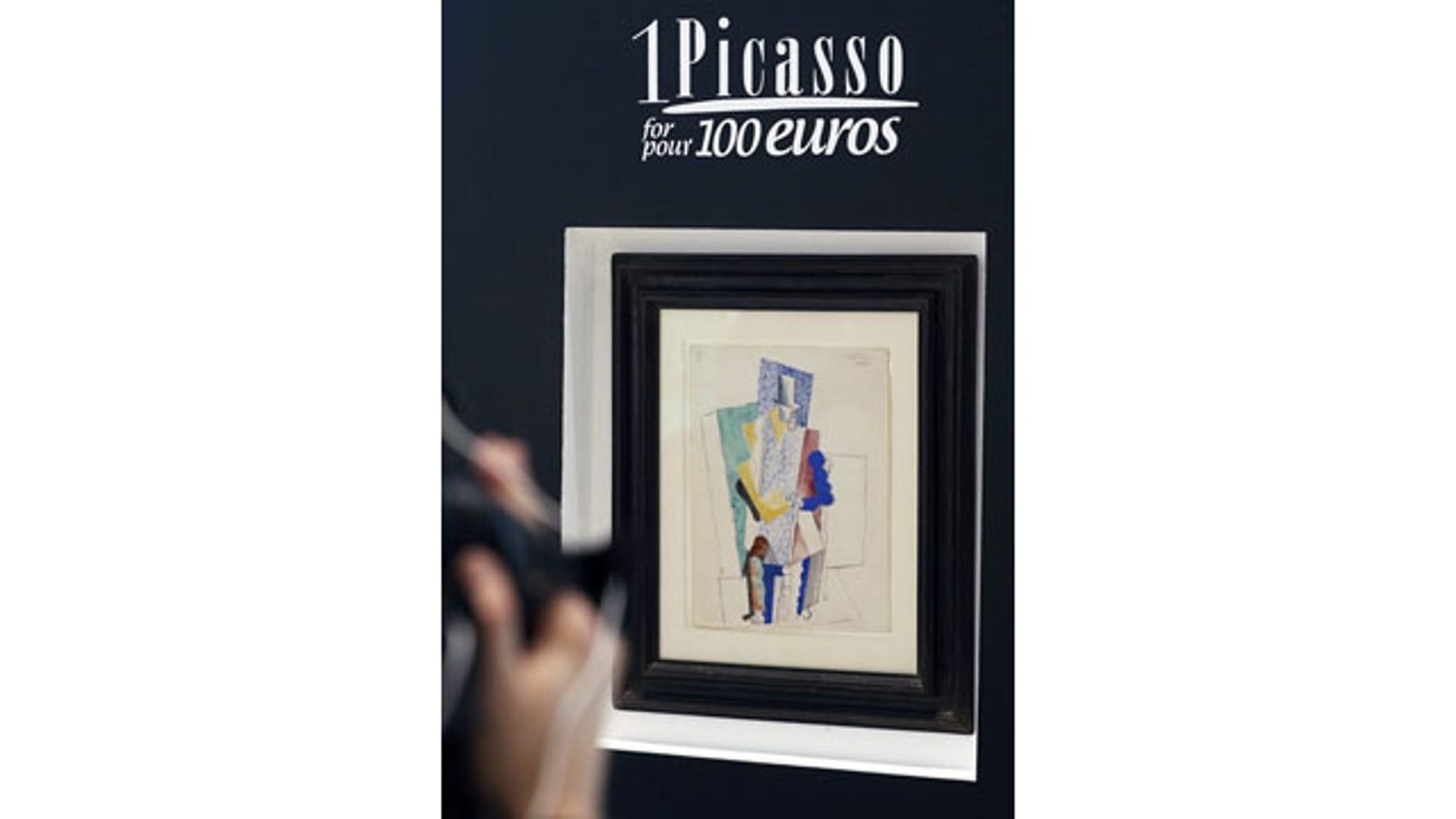 "December 12, 2013: Pablo Picasso's 1914 painting ""Man with Opera Hat"" on display in Paris (AP Photo)"