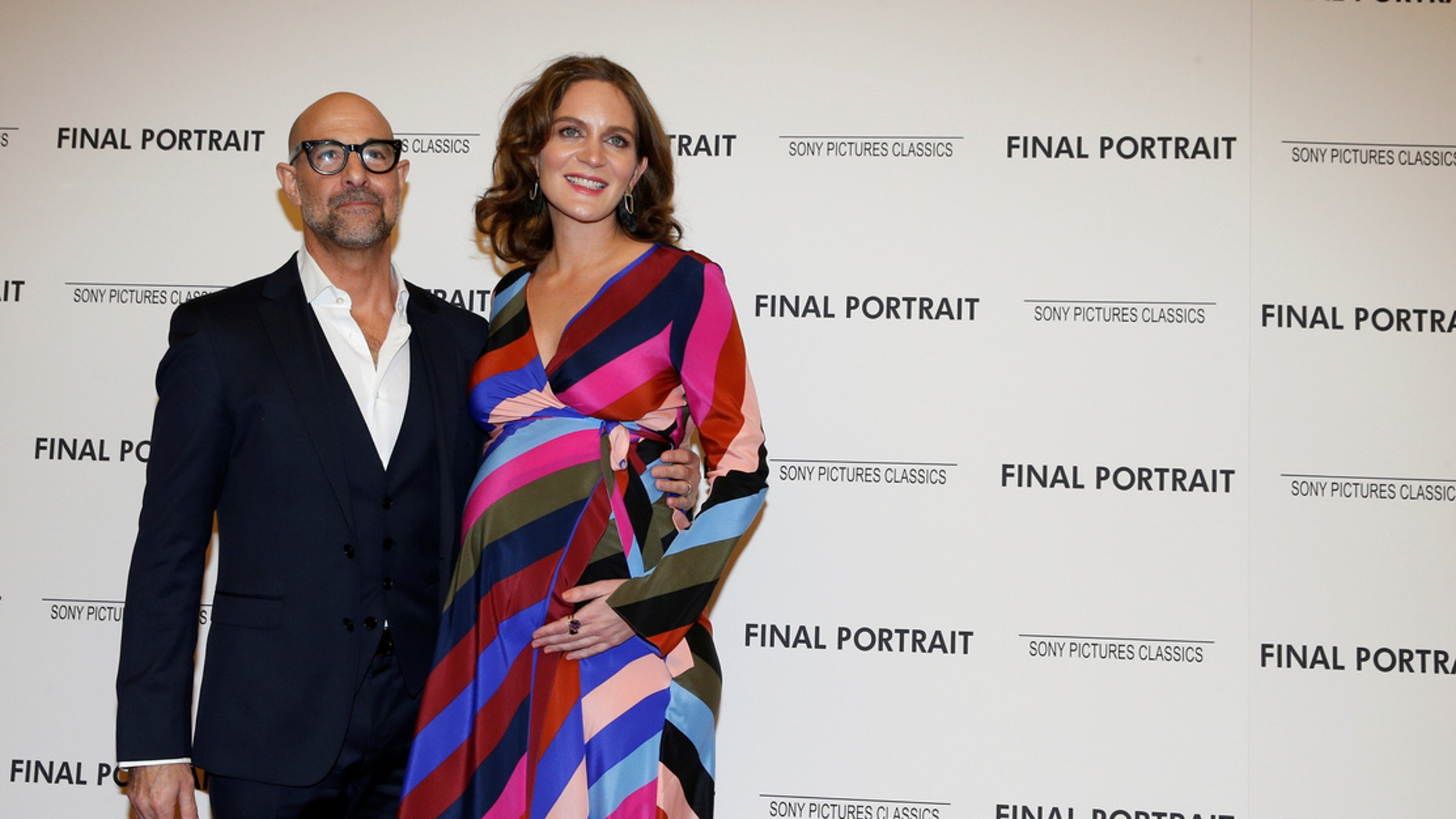 "Stanley Tucci arrives with his wife Felicity Blunt for a special screening of ""Final Portrait"" in New York."