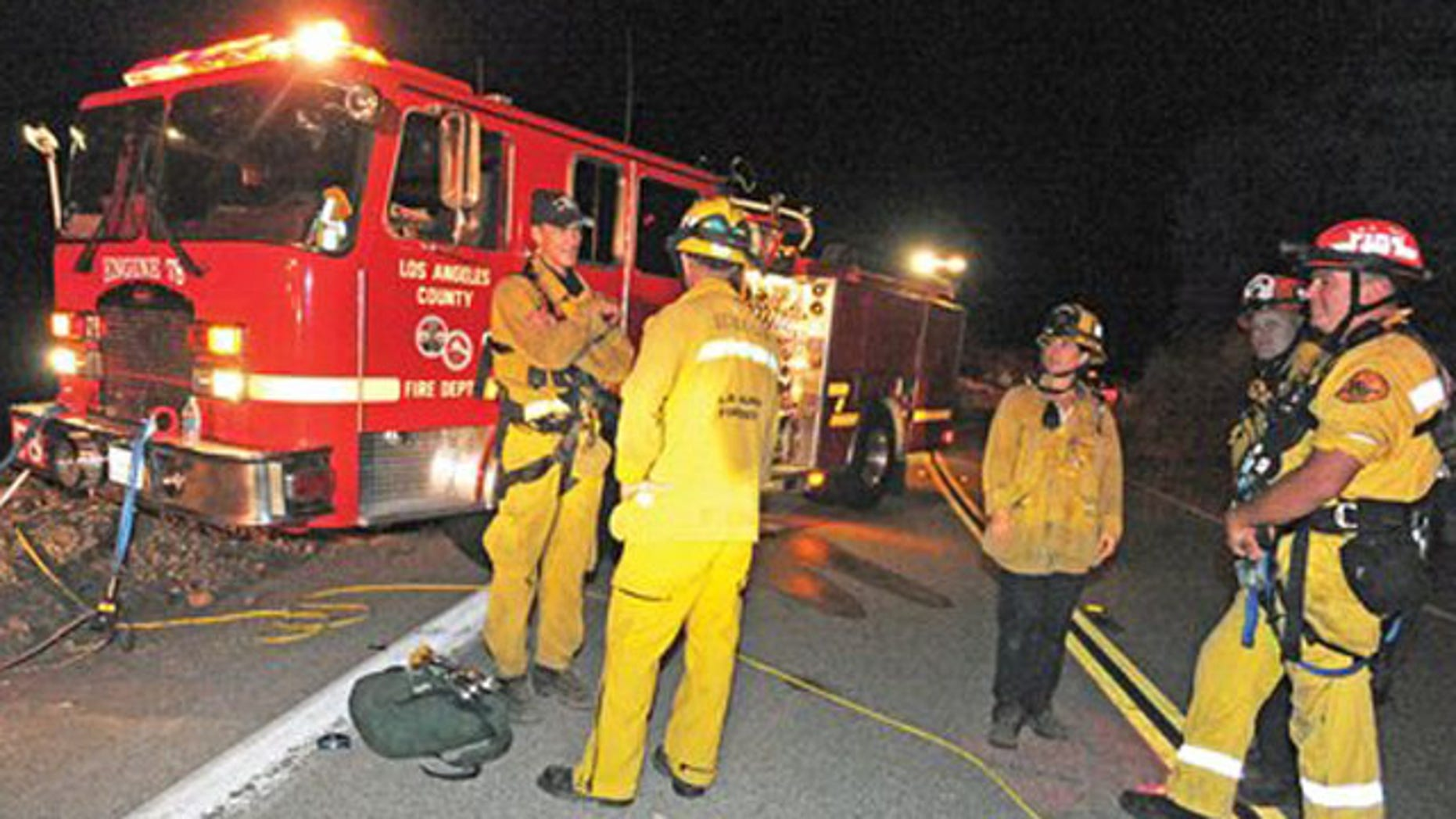 Sept. 29: Los Angeles County firefighters are stationed on Lake Hughes Road, where two vehicles were found off the side and approximately 200 feet in the canyon below in the Angeles National Forest.