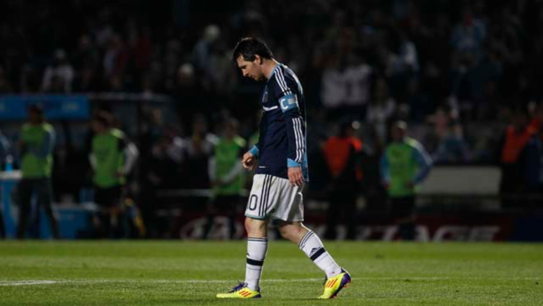 Argentina's Lionel Messi walks on the field during a Copa America quarterfinal  soccer match against Uruguay in Santa Fe, Argentina, Saturday, July 16, 2011. Uruguay advanced to the Copa America semifinals with a 5-4 victory over Argentina on penalties after a 1-1 draw. (AP Photo/Dolores Ochoa)