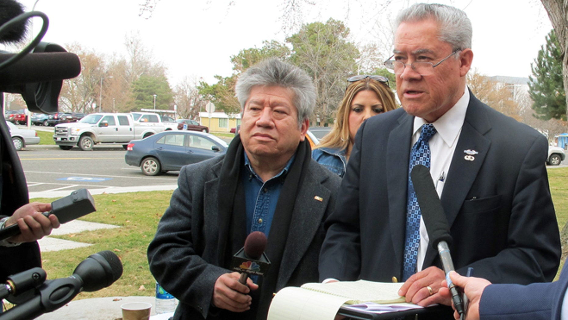 Activist Felix Vargas, right, talks with reporters, Wednesday, Feb. 25, 2015.