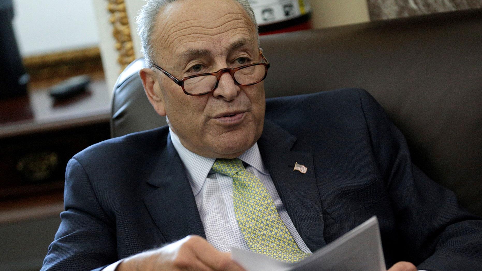 Oct. 18: Senate Minority Chuck Schumer speaks to reporters on Capitol Hill in Washington.