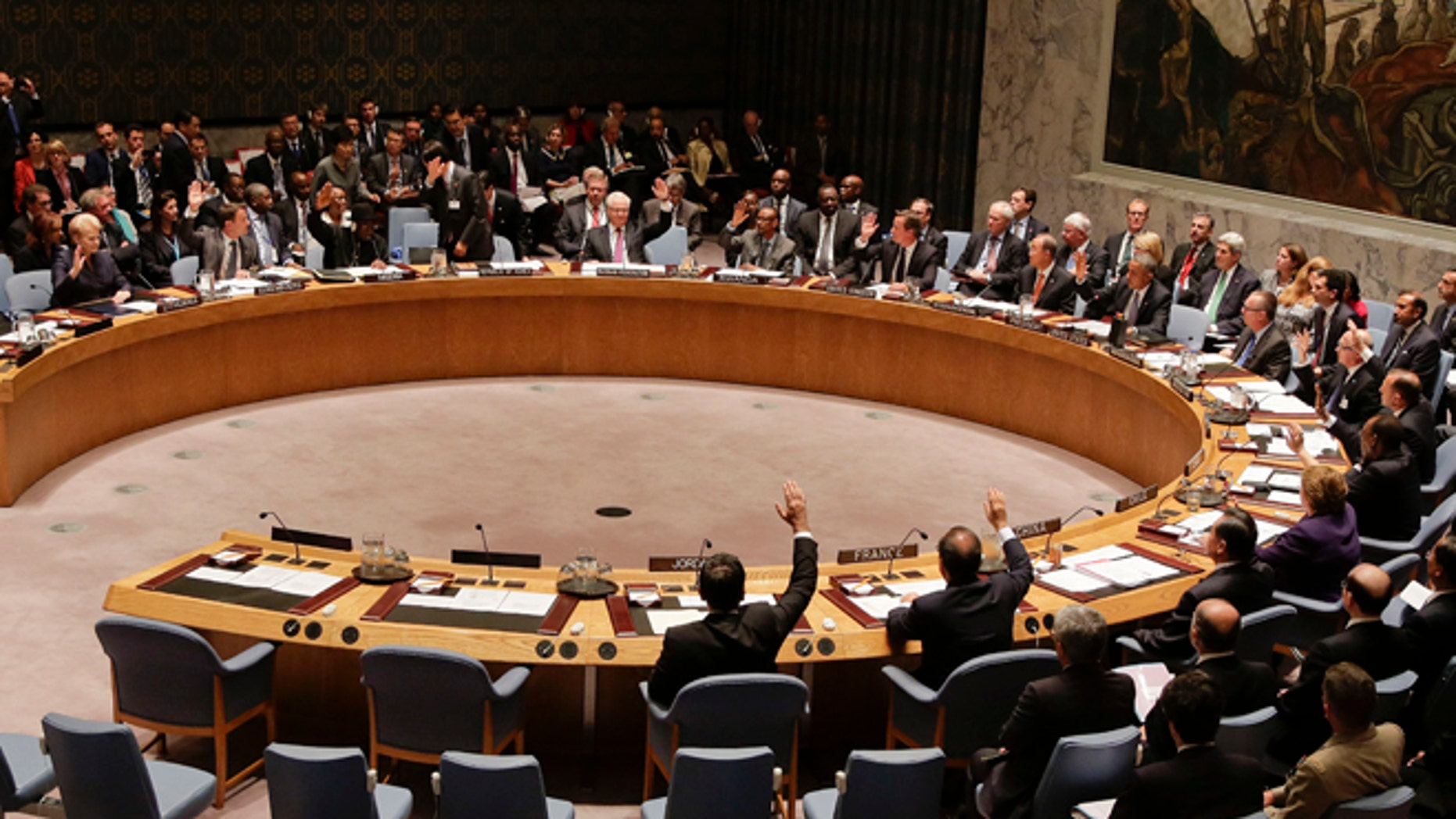 Heads of state vote on a resolution during a UN Security Council meeting, Wednesday, Sept. 24, 2014, at the United Nations. Members of the Security Council adopted a resolution that would require all countries to prevent the recruitment and transport of would-be foreign fighters preparing to join terrorist groups such as the Islamic State group. (AP Photo/Julie Jacobson)