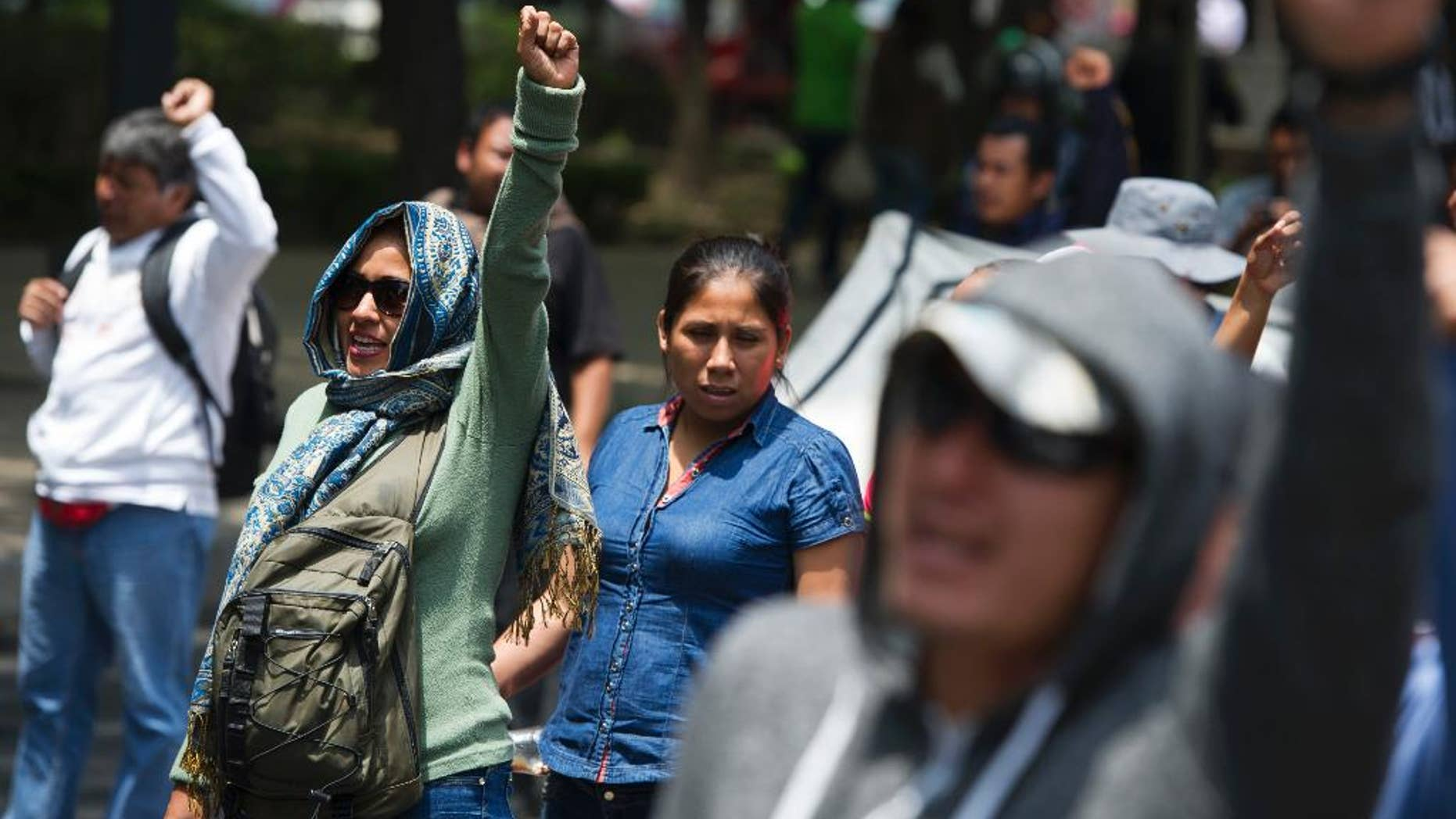 Protestors with the CNTE teachers union demonstrate along Paseo de la Reforma in Mexico City, Monday, June 13, 2016. The teachers union is striking against plans to overhaul the country's education system which include federally mandated teacher evaluations. (AP Photo/Nick Wagner)
