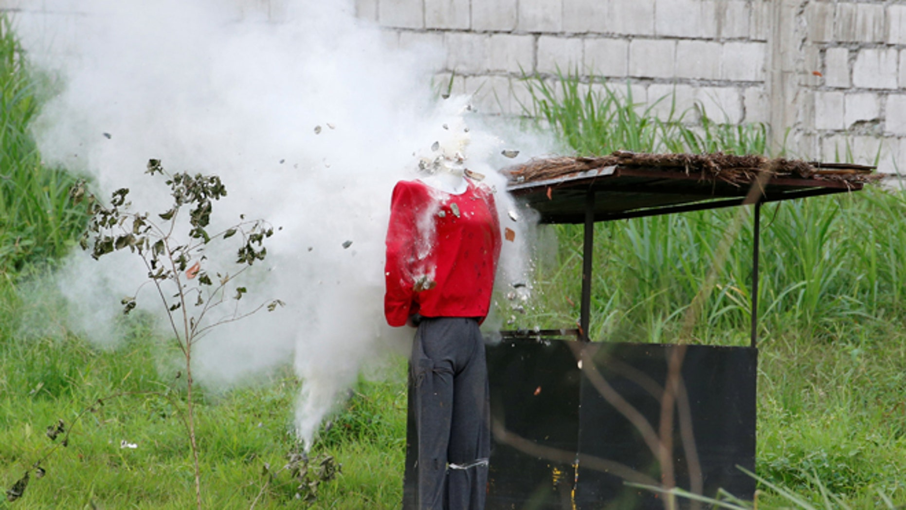 Sept. 15: A mannequin's head explodes during an assault drill by soldiers as they perform before Philippine President Rodrigo Duterte (not pictured) at the military's Scout Ranger Camp Tecson in San Miguel, Bulacan in northern Philippines