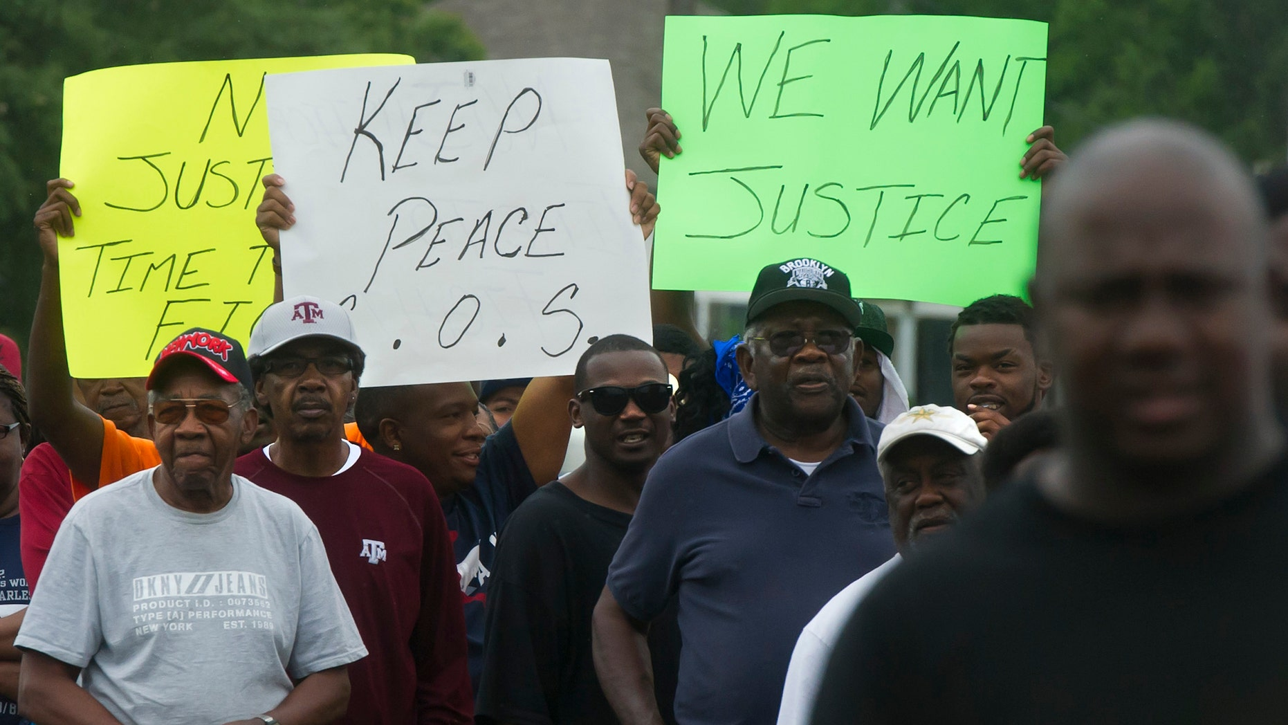 May 8, 2014: Protesters carry signs while marching to the  Hearne, Texas police department following the Tuesday shooting of 93-year-old woman.