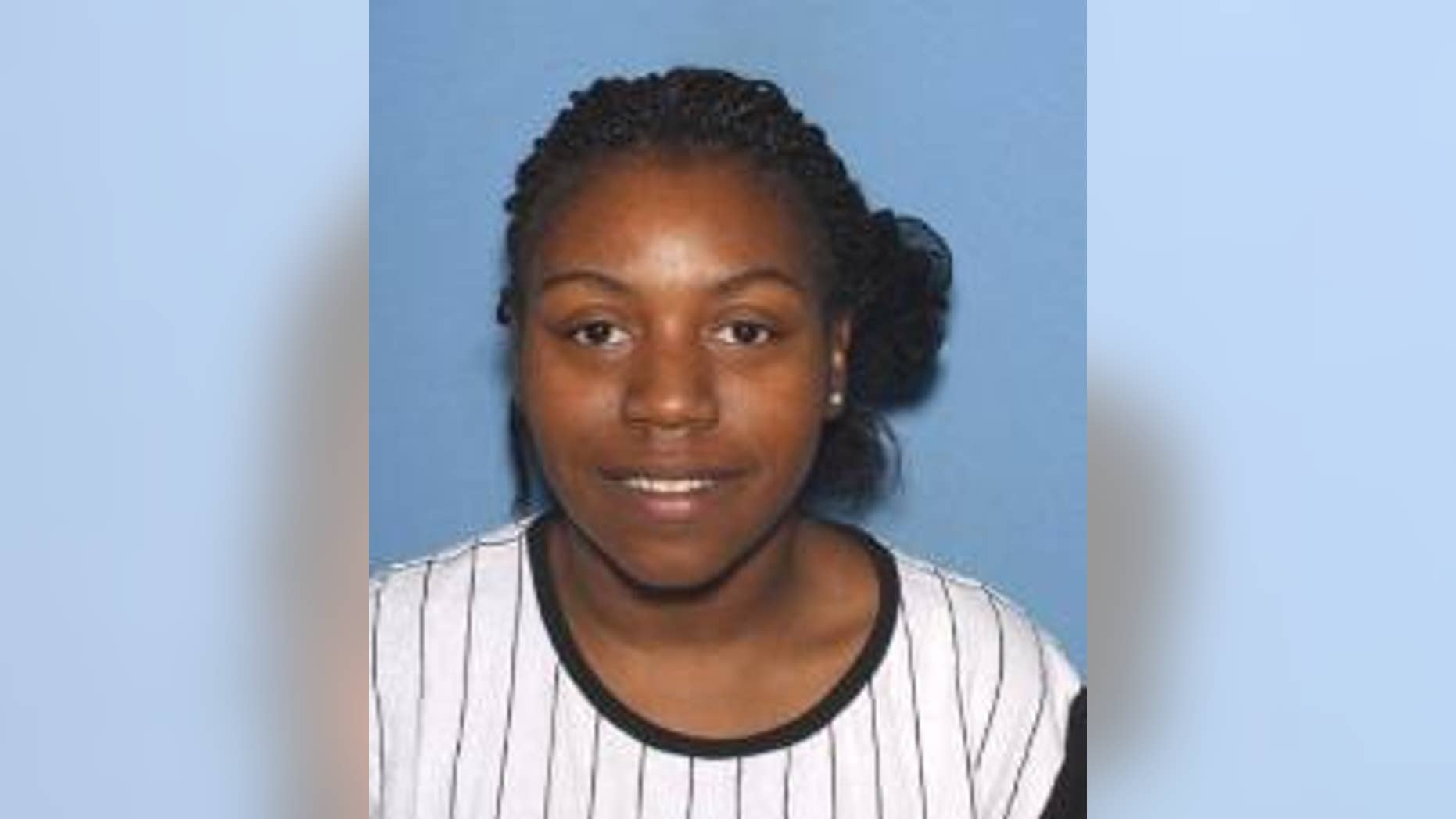 Keysheonna Reed, 24, was arrested Thursday in connection with the deaths of twins found in a suitcase in February.