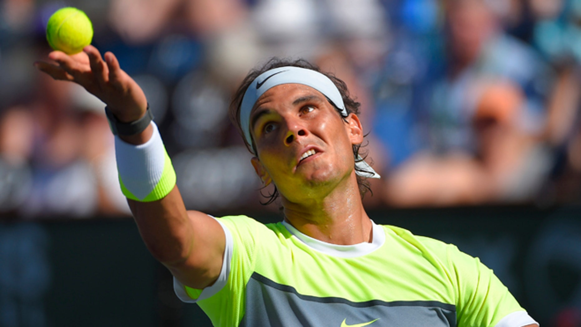 Rafael Nadal, of Spain, serves to Milos Raonic, of Canada, during their match at the BNP Paribas Open tennis tournament, Friday, March 20, 2015 in Indian Wells, Calif. (AP Photo/Mark J. Terrill)