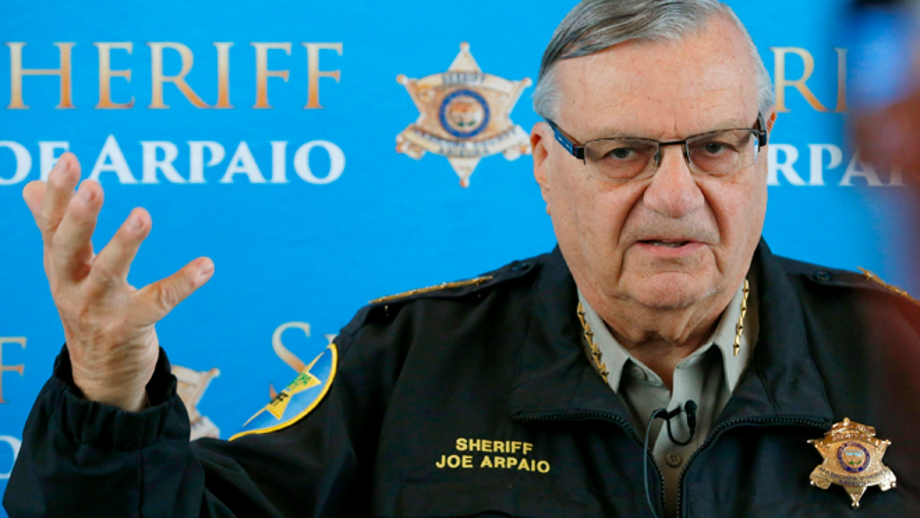 FILE - In this Dec. 18, 2013 file photo, Maricopa County Sheriff Joe Arpaio announces dozens of arrests in a prostitution sting during a news conference at Maricopa County Sheriff's Office Headquarters, in Phoenix. Arpaio and his top aide Chief Deputy Jerry Sheridan are required to appear before a federal judge who believes the two have mischaracterized and trivialized the judge's key findings in a racial-profiling decision issued in 2013 against the police agency. The sheriff's office will be required to provide answers Monday, March 24, 2014 to U.S. District Judge Murray Snow about an Oct. 18 training session in which the judge said Sheridan appears to suggest that rank-and-file deputies weren't obliged to make their best efforts to remedy the agency's constitutional violations. (AP Photo/Ross D. Franklin, File)