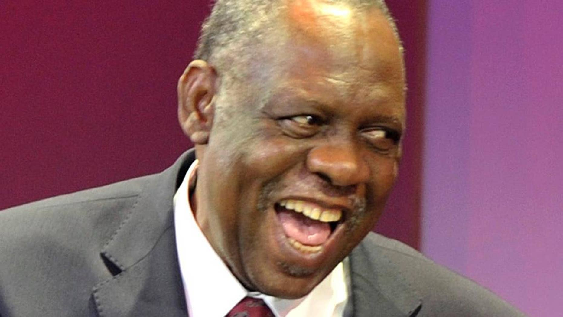FILE - In this Wednesday Oct. 24, 2012, file photo Confederation of African Football (CAF) president  Issa Hayatou attends the final draw of the Orange Africa Cup Of Nations in Durban South Africa. FIFA said Thursday, Oct. 8, 2015 that African soccer leader Isaa Hayatou will serve as acting president.   (AP Photo)