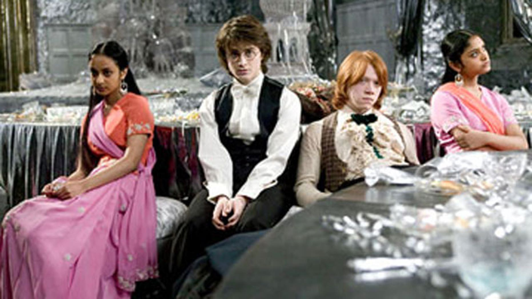 """Afshan Azad (far right) in a scene from the """"Harry Potter"""" movies. (Warner)"""