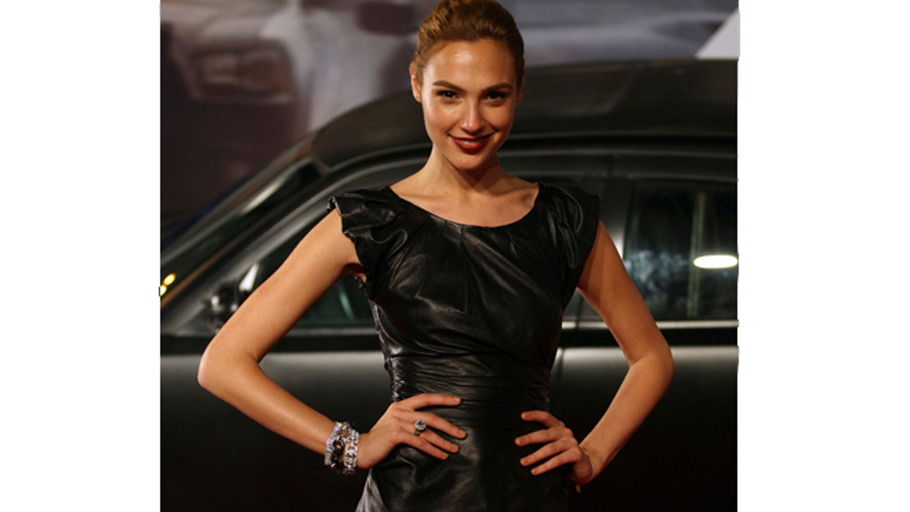 """Actress Gal Gadot poses at the world premiere of """"Fast Five"""" at the Cinepolis Lagoon theatre in Rio de Janeiro April 15, 2011."""