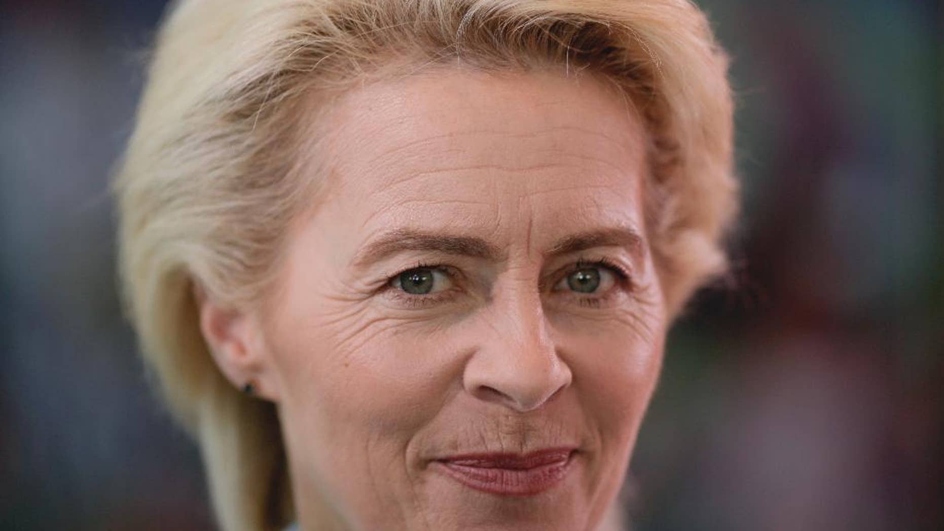 FILE - In this June 8, 2016 file photo German Defense Minister Ursula von der Leyen arrives for the cabinet meeting of the German government at the chancellery in Berlin. Von der Leyen wants to visit a Turkish base where German troops are stationed _ an announcement that comes days after a German deputy defense minister and lawmakers were denied a visit there by Turkey. (AP Photo/Markus Schreiber, file)