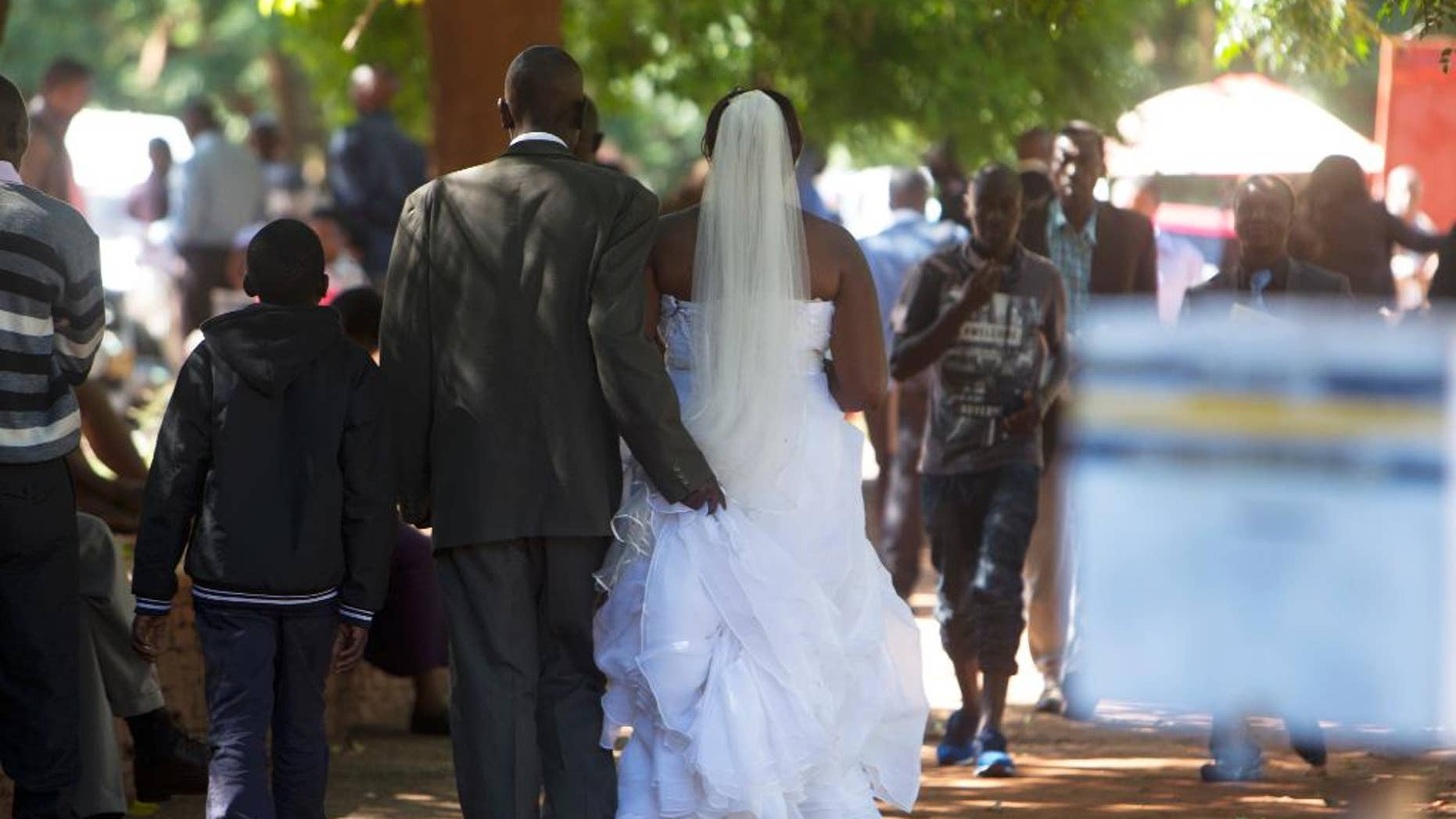 """A couple leaves the magistrates courts after tying the knot in Harare, Tuesday, January, 24, 2017.For many Zimbabwean women, the death of a husband means much more than loosing a spouse. What follows is usually a rush by in laws for property, stripping the widow and her children bare, a phenomenon described by Human Rights Watch in a report launched Tuesday as """"profound injustice"""". (AP Photo/Tsvangirayi Mukwazhi)"""