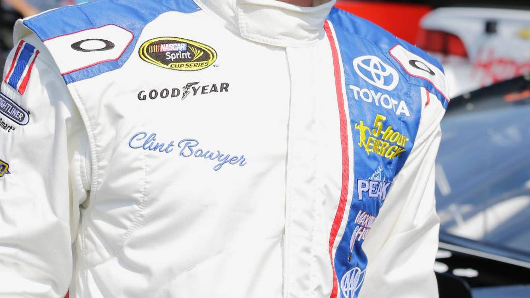 Clint Bowyer walks through the garage before a NASCAR Sprint Cup practice session at Darlington Raceway in Darlington, S.C., Friday, Sept. 4, 2015. (AP Photo/Terry Renna)