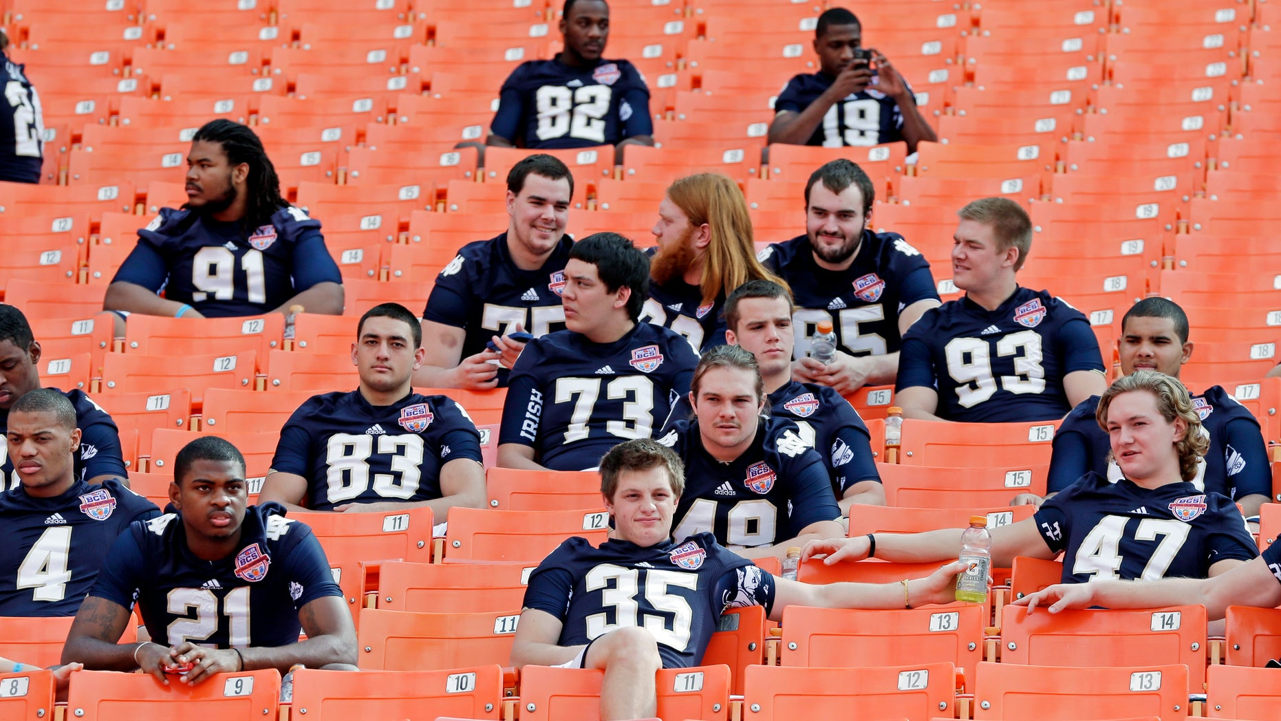 Notre Dame players watch from the stands during Media Day for the BCS National Championship college football game Saturday, Jan. 5, 2013, in Miami. Notre Dame faces Alabama in Monday's championship game.(AP Photo/Chris O'Meara)