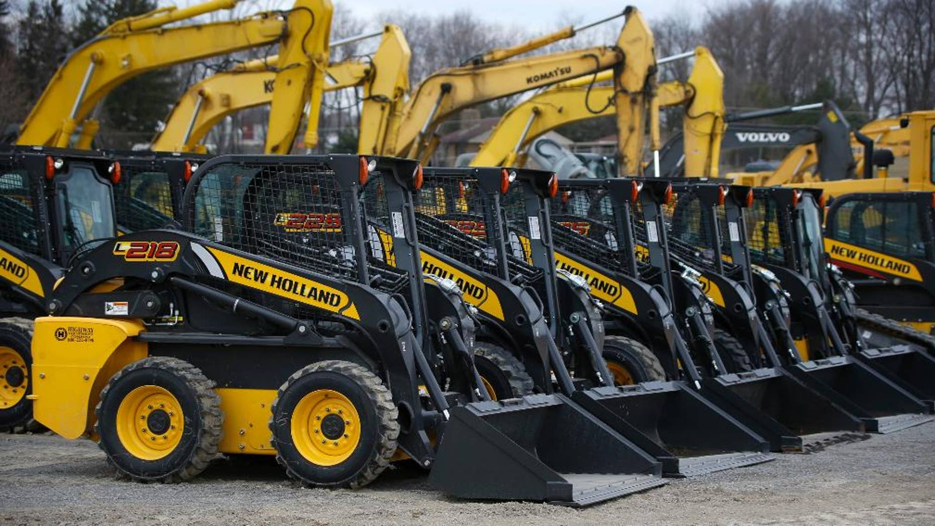 In this Friday, March 28, 2014 photo, earth-moving and construction equipment is stored on a lot at the Highway Equipment Company in Zelienople, Pa. The Commerce Department releases business inventories for March on Tuesday, May 13, 2014. (AP Photo/Keith Srakocic)