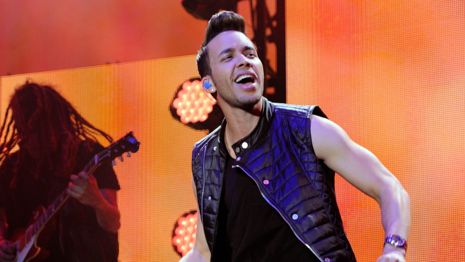 "FILE - In this Nov. 22, 2014 file photo, Prince Royce performs at the iHeart Radio Fiesta Latina concert at The Forum, in Inglewood, Calif. Prince Royce has been invited to participate in the soundtrack of ""Furious 7"" ""My Angel"" (Photo by Chris Pizzello/Invision/AP File)"