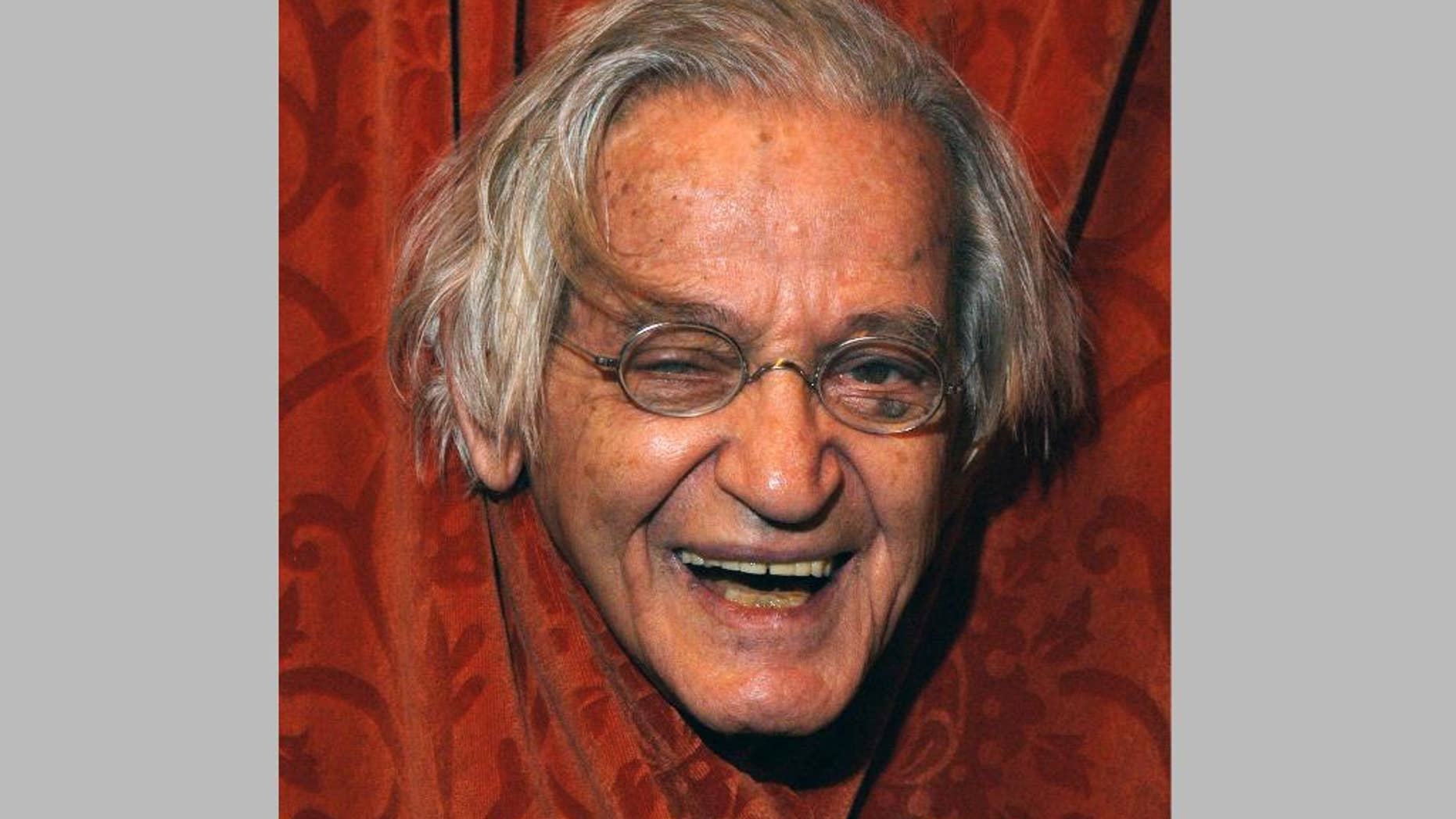 """FILE - This April 24, 2004 file photo shows comedian Irwin Corey at the Ethel Barrymore Theatre in New York. Corey, the wild-haired comedian and actor who was known for his nonsensical style and who billed himself as """"The World's Foremost Authority,"""" died Monday, Feb. 6, 2017, at his home in Manhattan. He was 102. (AP Photo/Jim Cooper, File)"""