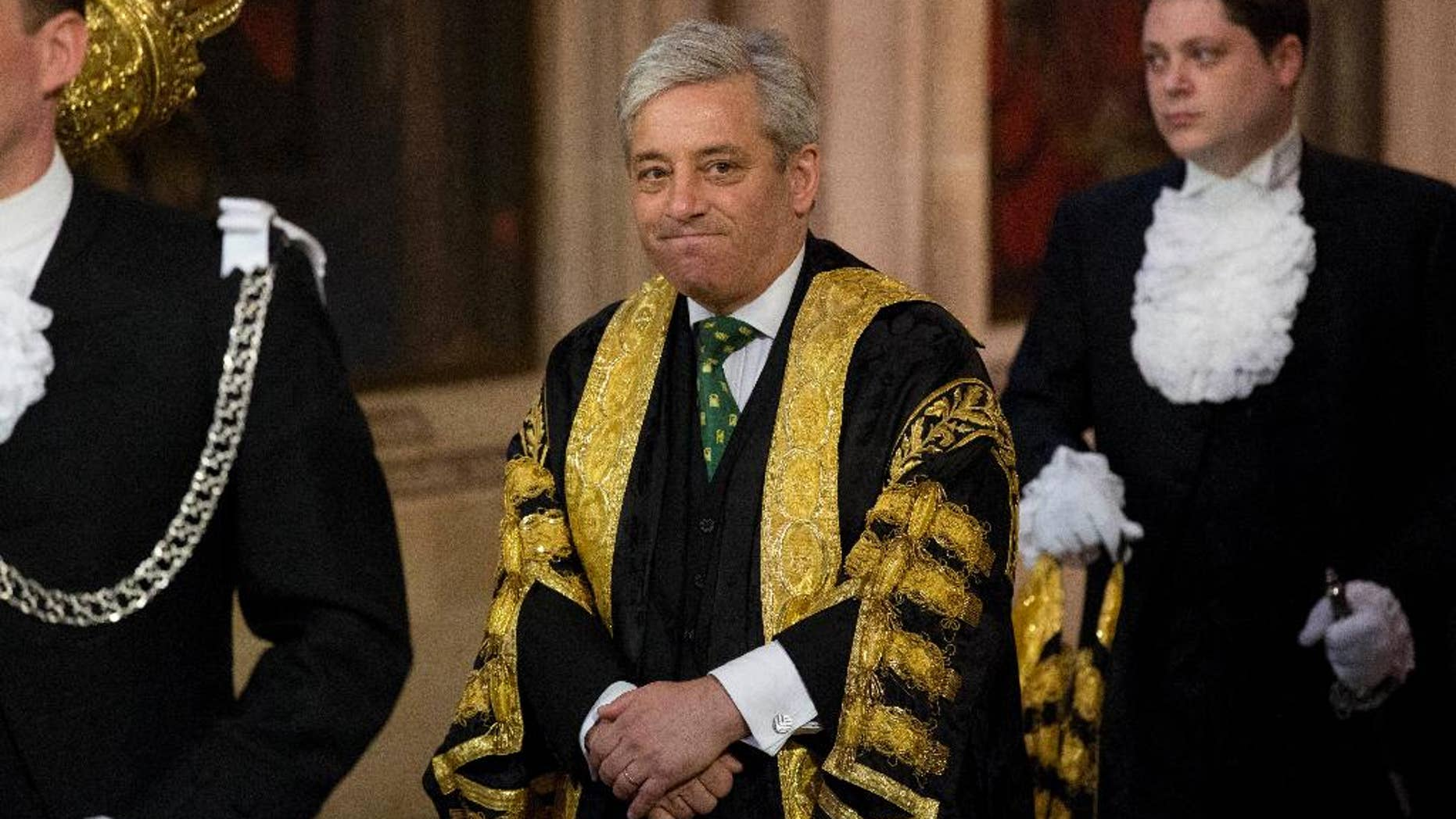 FILE - A Wednesday, June 4, 2014 file photo of Britain's Speaker of the House of Commons John Bercow as he walks through Central Lobby before Britain's Queen Elizabeth II delivered the Queen's Speech at the State Opening of Parliament at the Palace of Westminster in London. The Speaker of Britain's House of Commons says he strongly opposes letting U.S. President Donald Trump address Parliament during a state visit to the U.K. John Bercow said Monday, Feb. 6, 2017, that he would have opposed the invitation even before Trump's temporary ban on citizens of seven majority-Muslim nations from entering the U.S. (AP Photo/Matt Dunham, Pool, File)