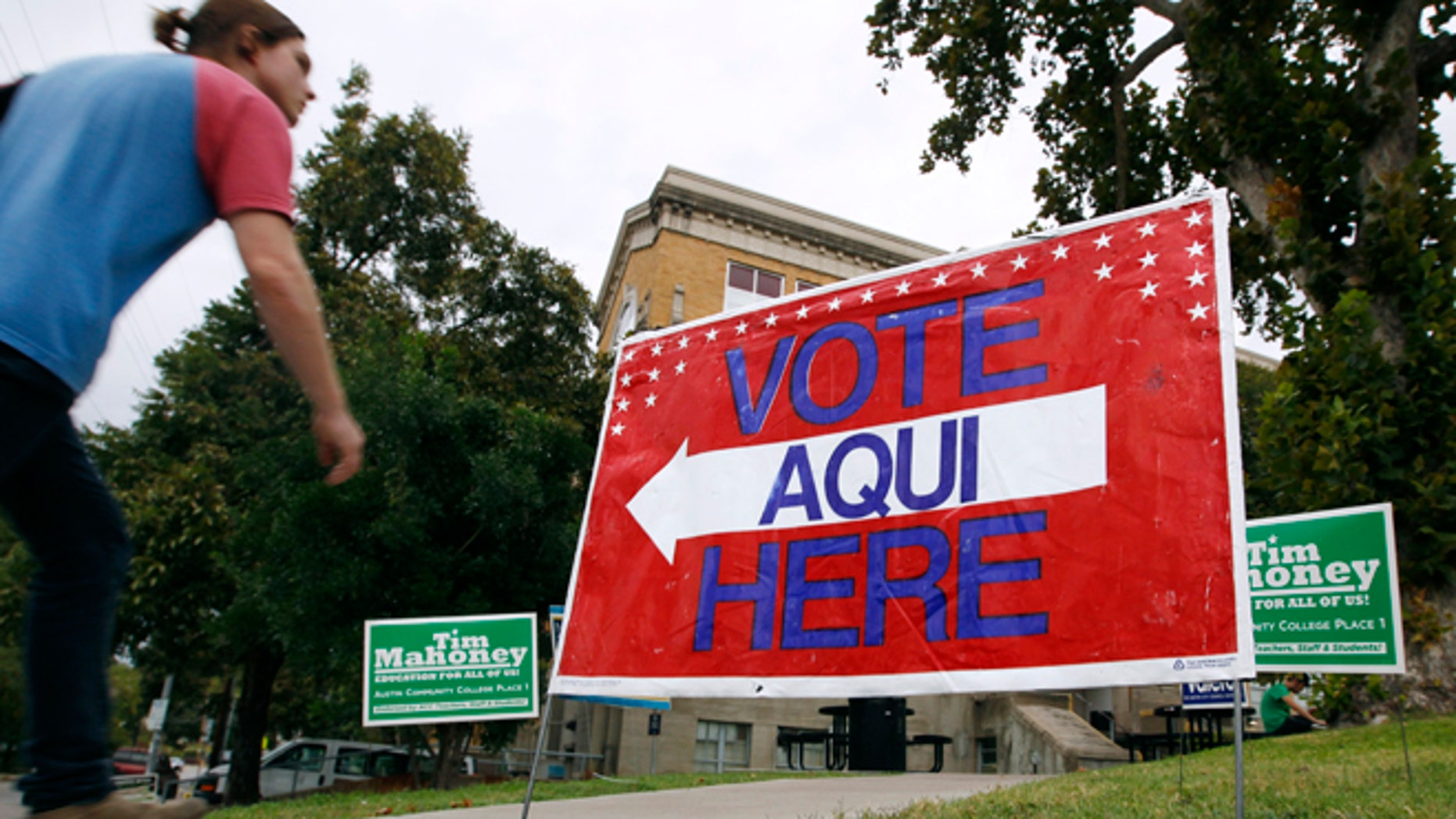 AUSTIN, TX - NOVEMBER 4:  A sign shows the way to the polling station at Austin Community College on November 4, 2014 in Austin, Texas. Voters headed to the polls today to decide a number of tight races. (Photo by Erich Schlegel/Getty Images)
