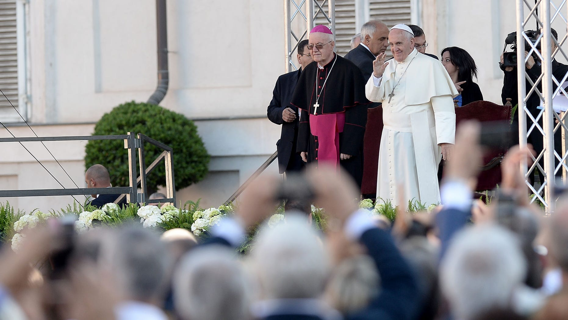 Pope Francis Pope Francis waves during as he meets with workers and businessmen during his visit to Turin, northern Italy, Sunday, June 21, 2015. Pope Francis earlier prayed in front of the Holy Shroud, the 14 foot-long linen revered by some as the burial cloth of Jesus, on display at the Cathedral of Turin. (AP Photo/Massimo Pinca)