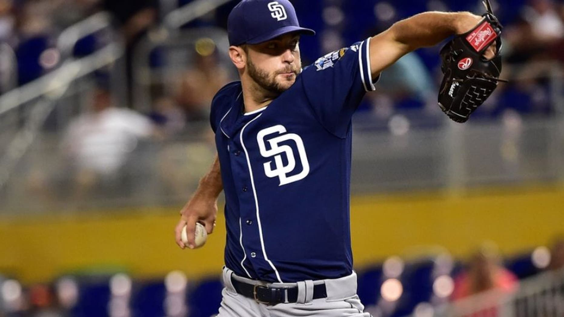 Aug 26, 2016; Miami, FL, USA; San Diego Padres starting pitcher Jarred Cosart (55) throws during the first inning against the Miami Marlins at Marlins Park. Mandatory Credit: Steve Mitchell-USA TODAY Sports