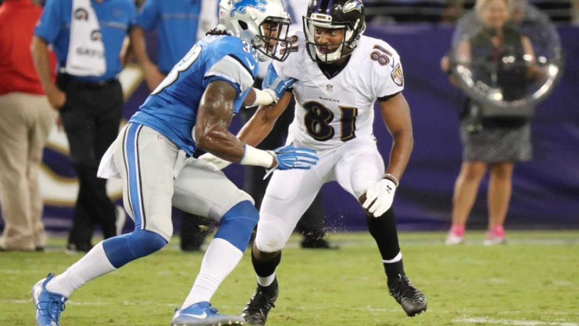 Aug 27, 2016; Baltimore, MD, USA; Baltimore Ravens wide receiver Keenan Reynolds (81) blocks Detroit Lions cornerback Alex Carter (33) at M&T Bank Stadium. Mandatory Credit: Mitch Stringer-USA TODAY Sports