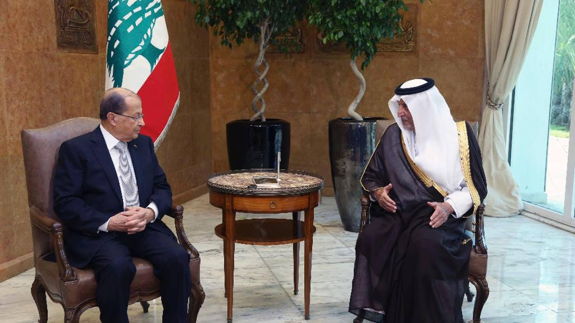 In this photo released by Lebanon's official government photographer Dalati Nohra, Lebanese President Michel Aoun, left, meets with Saudi Arabia's Prince Khaled al-Faisal, at the Presidential Palace in Baabda, east of Beirut, Lebanon, Monday, Nov. 21, 2016. al-Faisal said, he handed an invitation to the newly elected Lebanese president to visit the oil-rich kingdom. (Dalati Nohra via AP)