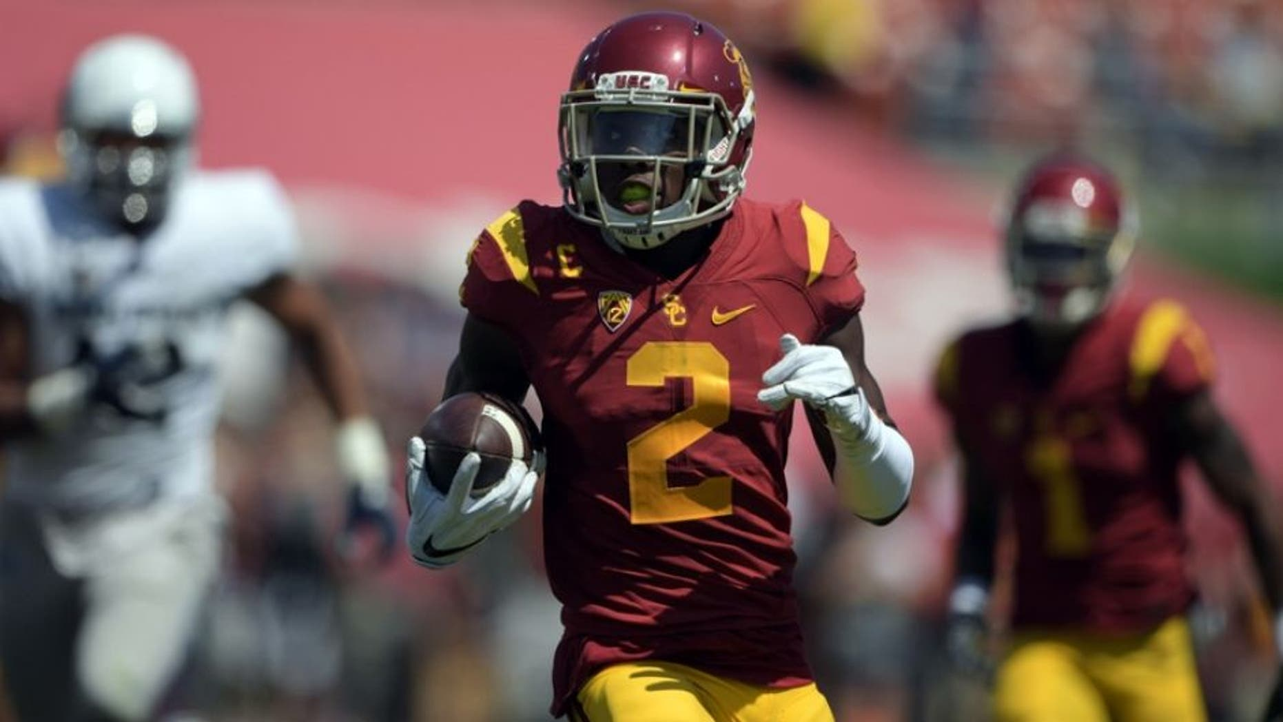 Sep 10, 2016; Los Angeles, CA, USA; USC Trojans defensive back Adoree Jackson (2) scores on a 79-yard punt return in the third quarter against the Utah State Aggies during a NCAA football game at Los Angeles Memorial Coliseum. Mandatory Credit: Kirby Lee-USA TODAY Sports