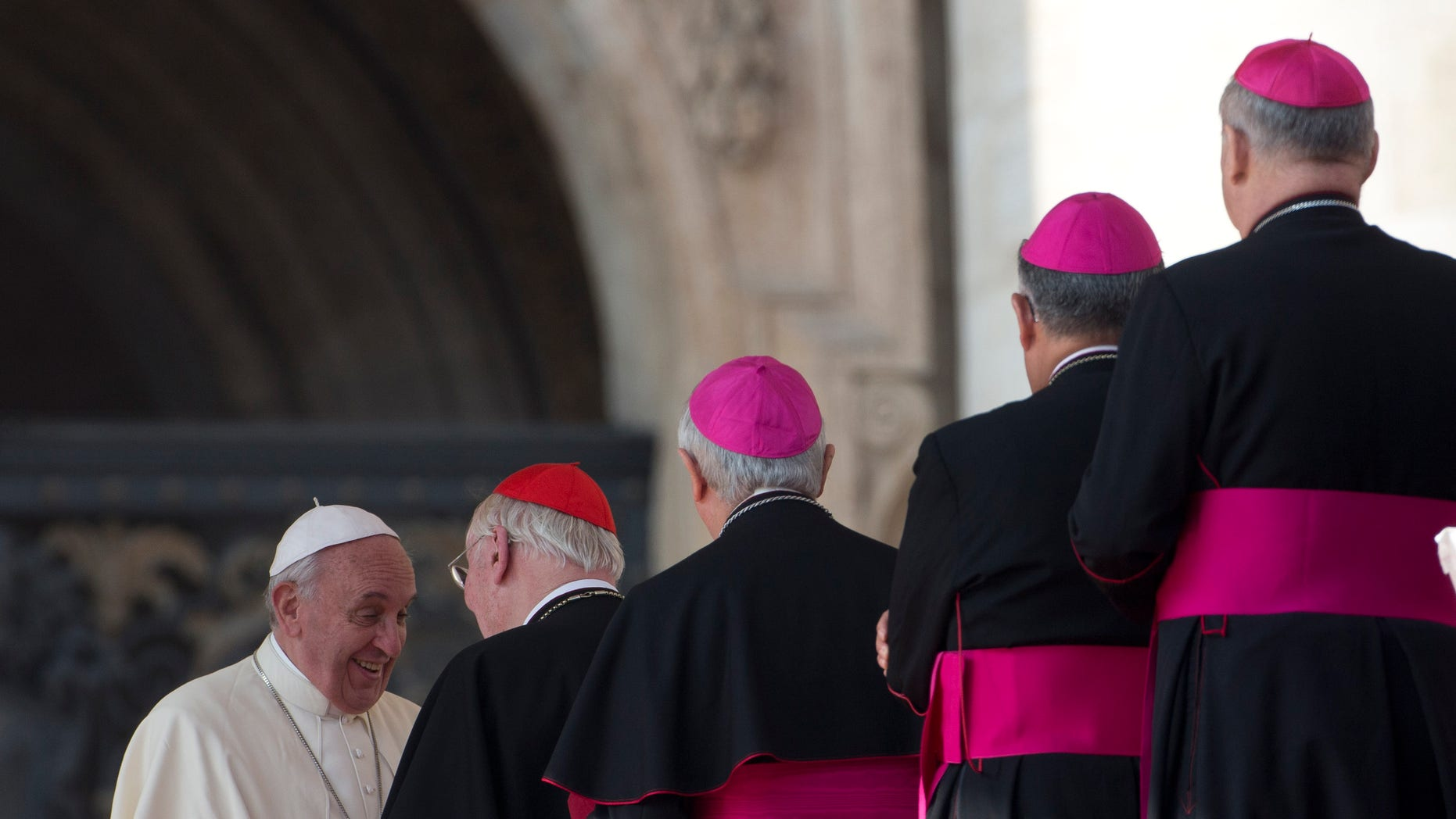 Cardinals and Bishops line up to greet Pope Francis at the end of his weekly general audience in St. Peter's Square at the Vatican, Wednesday, Oct. 30, 2013.(AP Photo/Alessandra Tarantino)