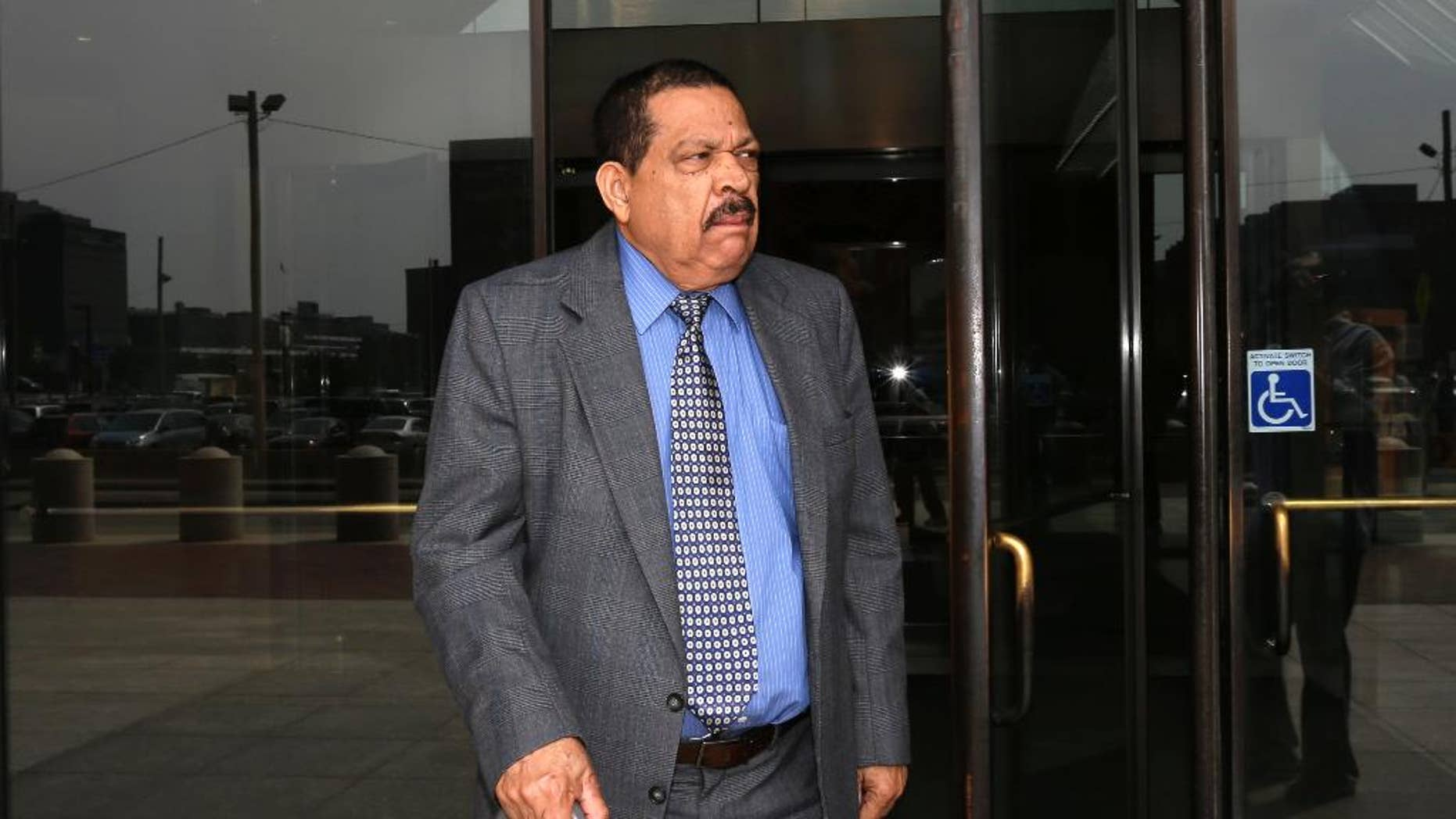 FILE - In this Aug. 22, 2013 file photo, former El Salvadoran military Col. Inocente Orlando Montano departs federal court, in Boston.  More than a year after a his extradition was ordered, the former Salvadoran colonel remains far from answering charges of plotting the 1989 deaths of six Jesuit priests as an American judge considers legal entanglements still reverberating long after the country's civil war. Now the failing health of 75-year-old Inocente Orlando Montano Morales raises the question of whether he will live long enough to face trial in Spain or El Salvador.  (AP Photo/Steven Senne, File)
