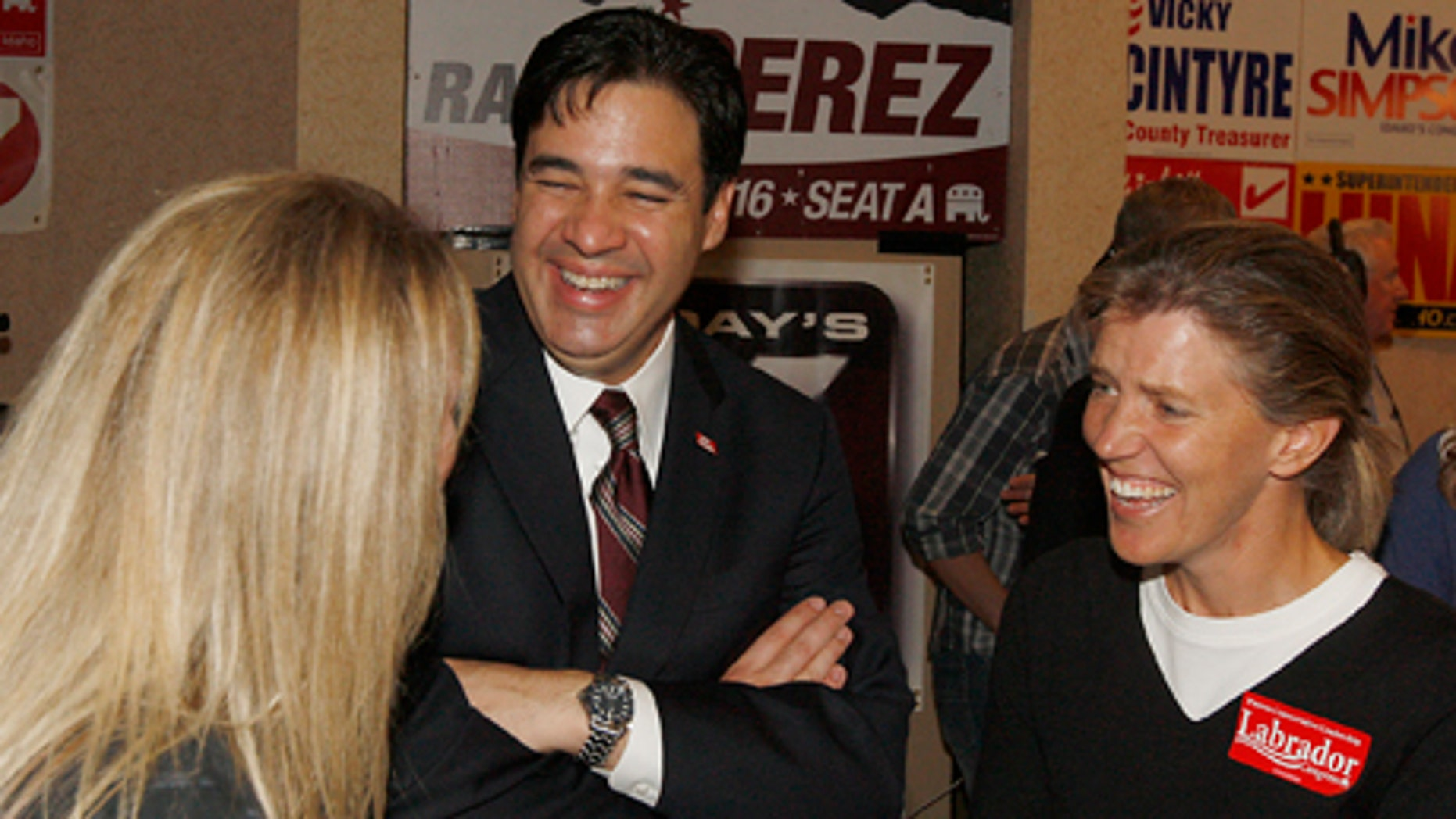 Raul Labrador talks with supporters Martha Johnson, right, and Kathy Johnson, left, at the Republican Party Election Headquarters at a hotel in Boise, Idaho on Tuesday, Nov. 2, 2010. Labrador is facing off against Democratic incumbant Walt Minnick for Idaho's 1st Congressional District.  (AP Photo/Matt Cilley)