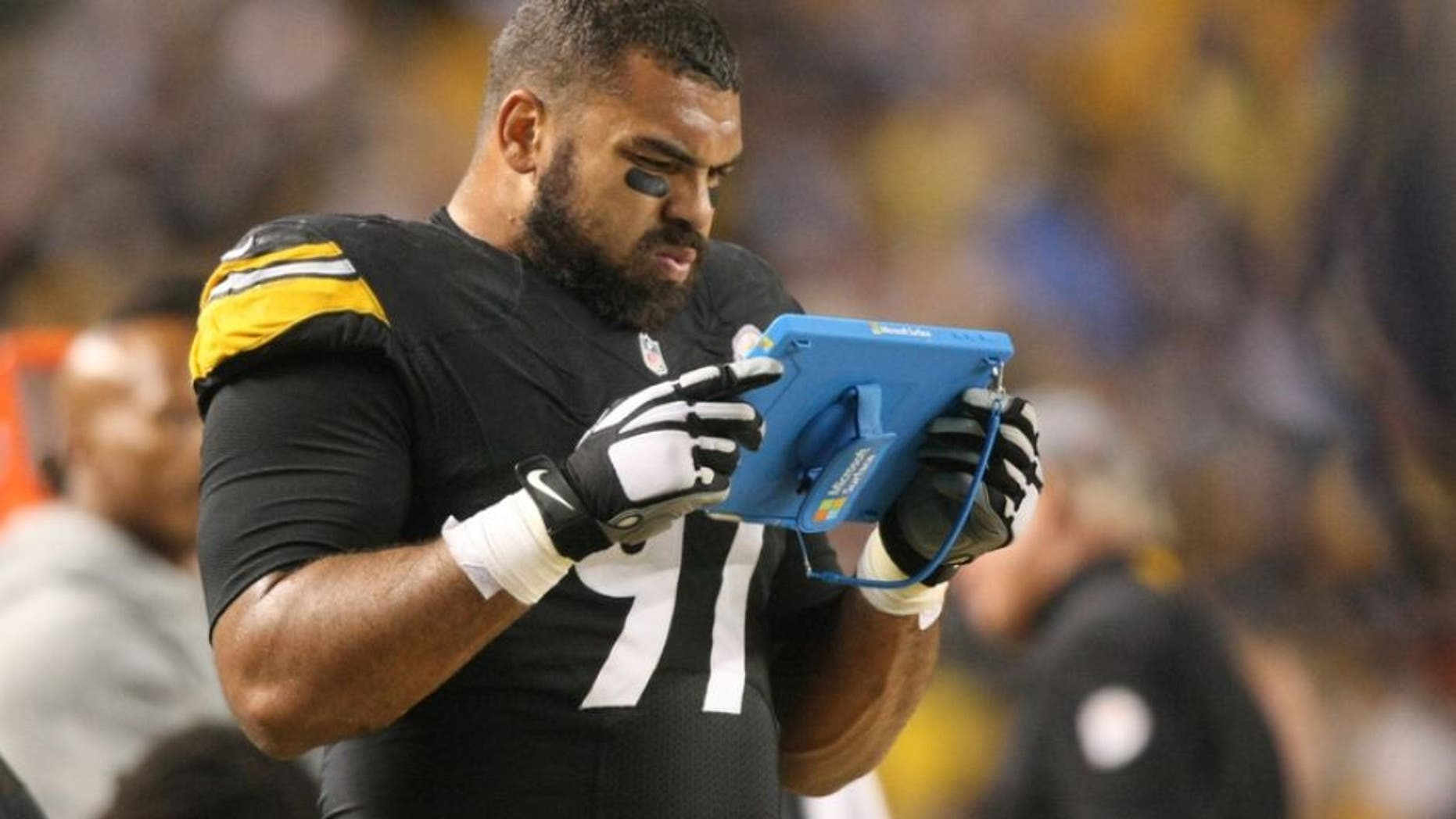 Oct 2, 2016; Pittsburgh, PA, USA; Pittsburgh Steelers defensive end Cameron Heyward (97) reviews a play on a tablet during the first half of the game against the Kansas City Chiefs at Heinz Field. Mandatory Credit: Jason Bridge-USA TODAY Sports