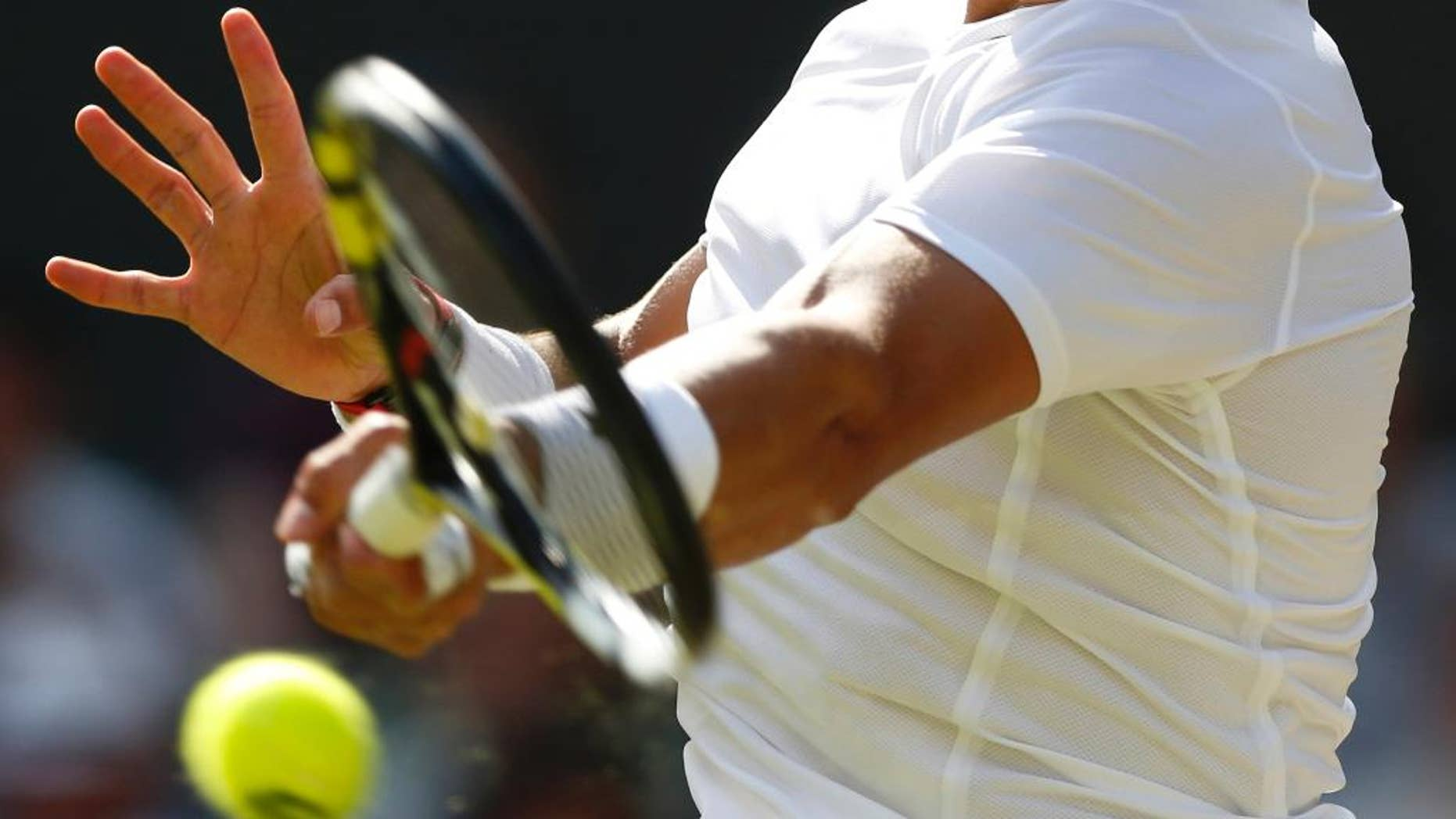 Rafael Nadal of Spain plays a return to Nick Kyrgios of Australia during their men's singles match at the All England Lawn Tennis Championships in Wimbledon, London, Tuesday July 1, 2014. (AP Photo/Ben Curtis)